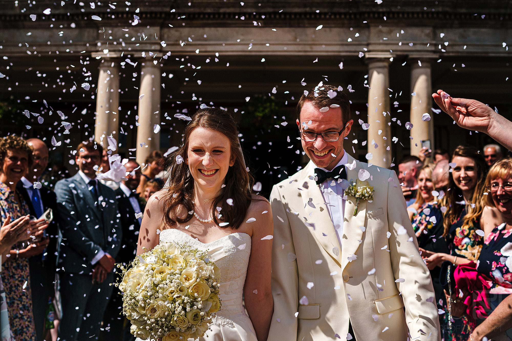 newlyweds walking through confetti