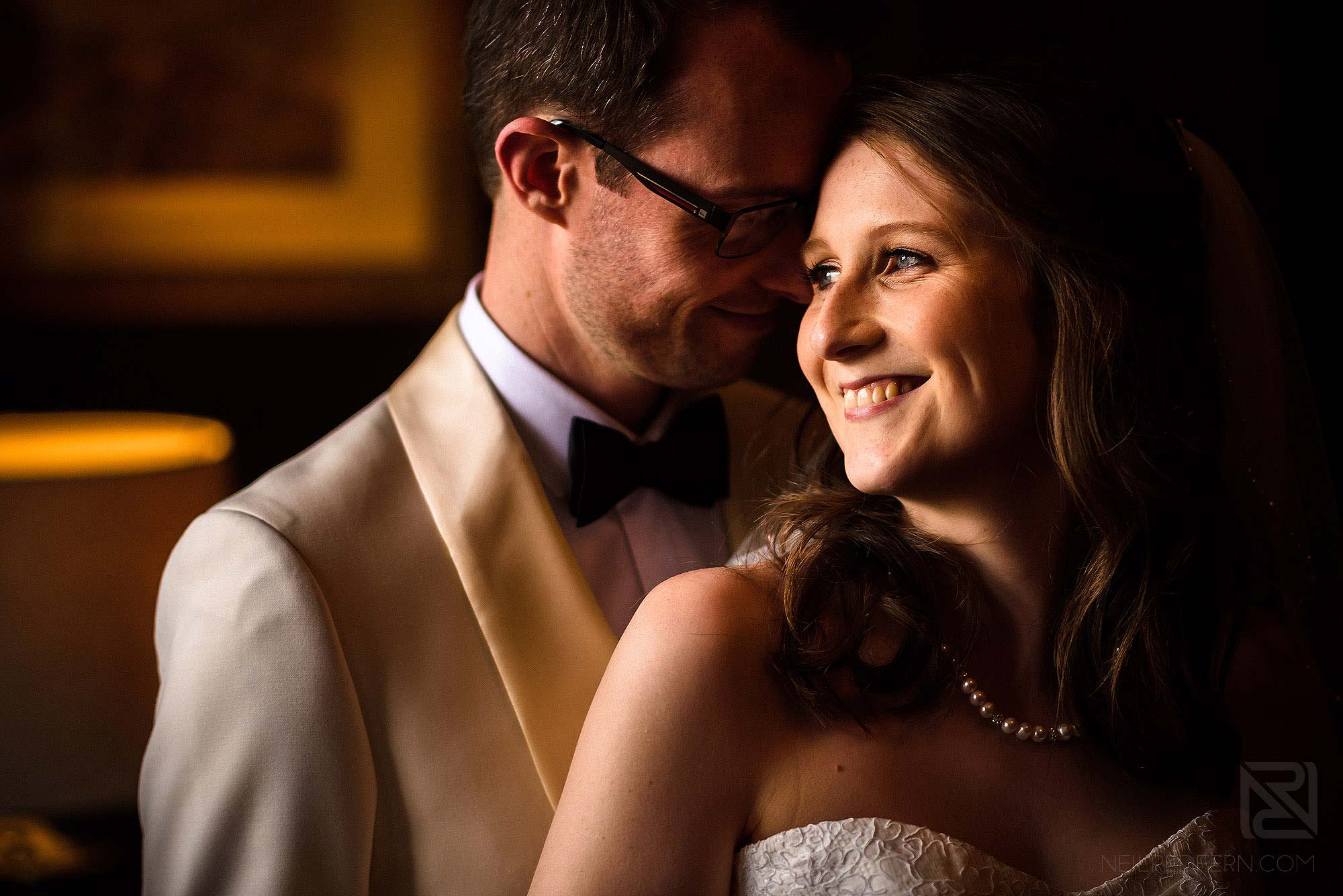 natural light portrait of bride and groom inside Eaves Hall