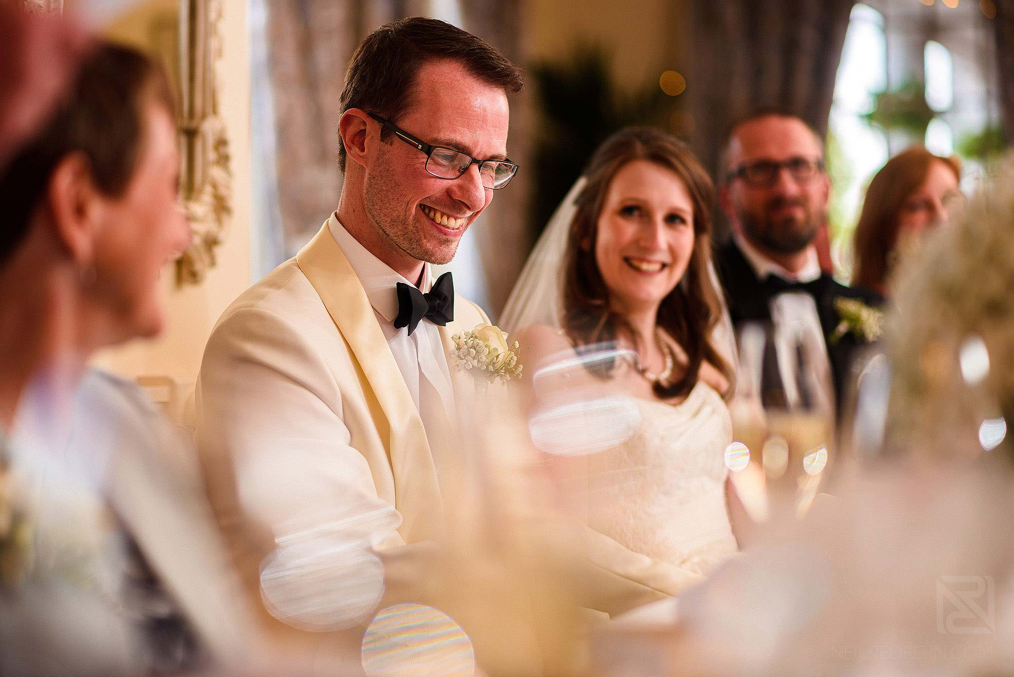groom laughing during best man's speech