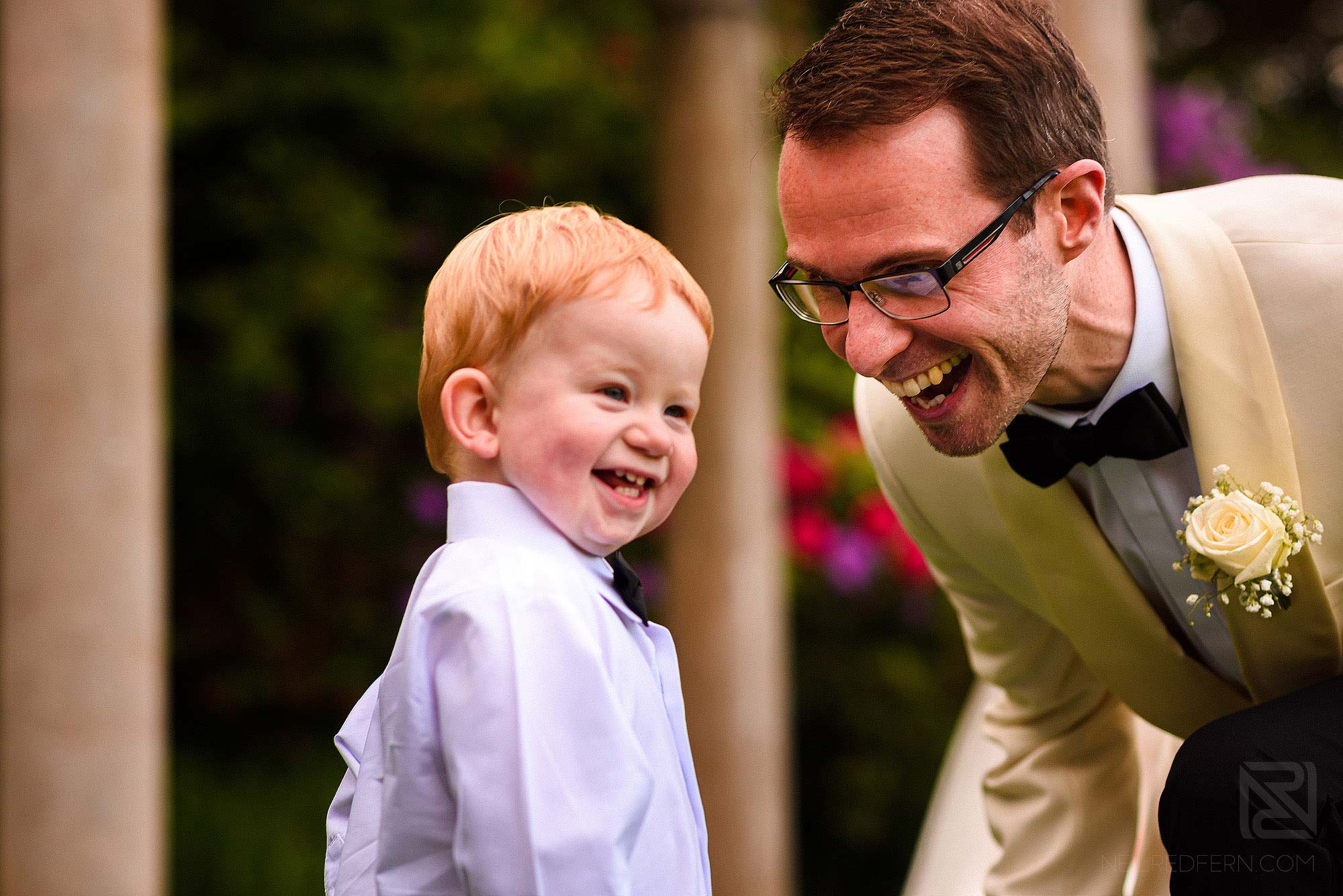 page boy laughing with groom
