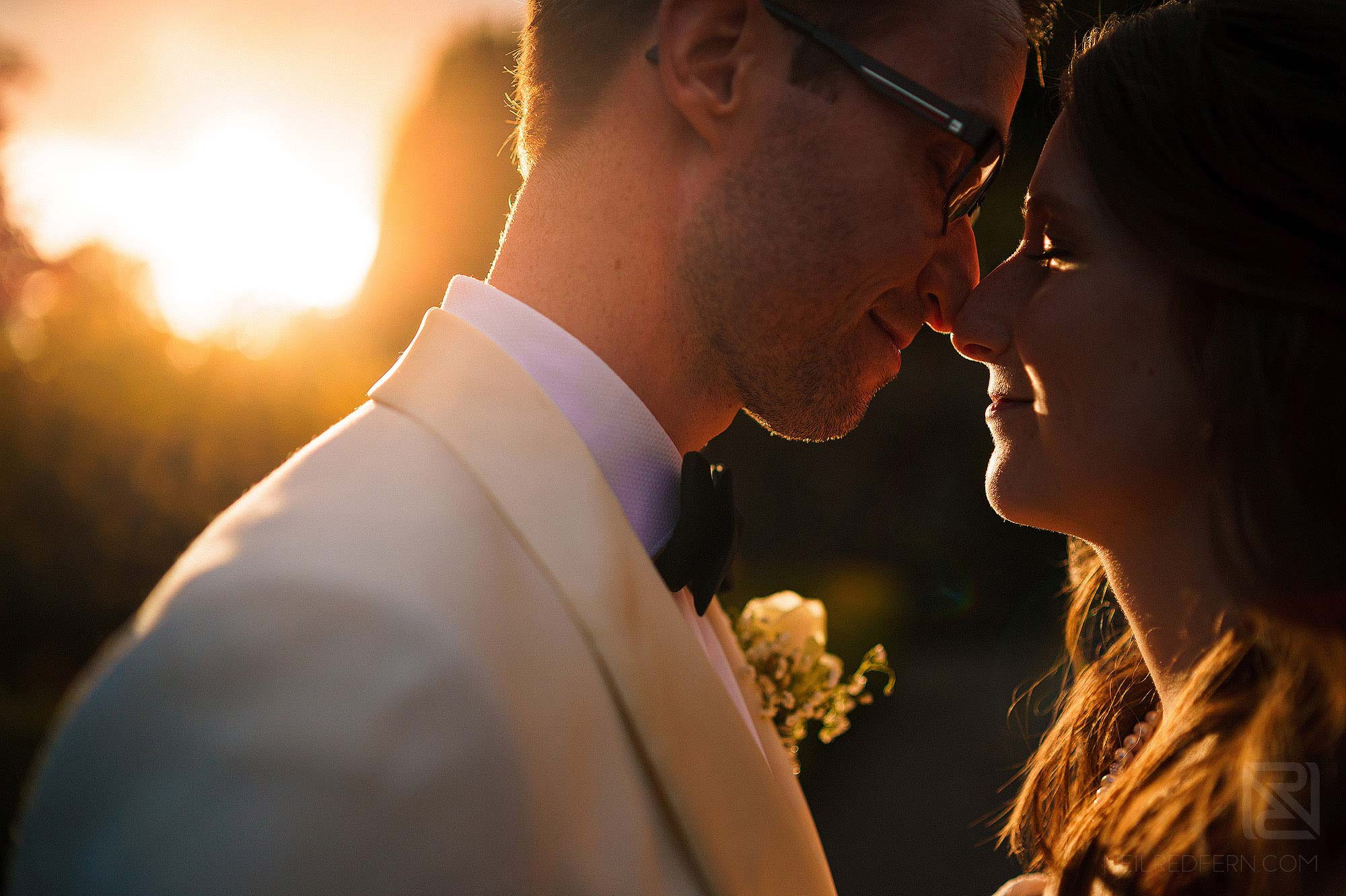 portrait of bride and groom at sunset