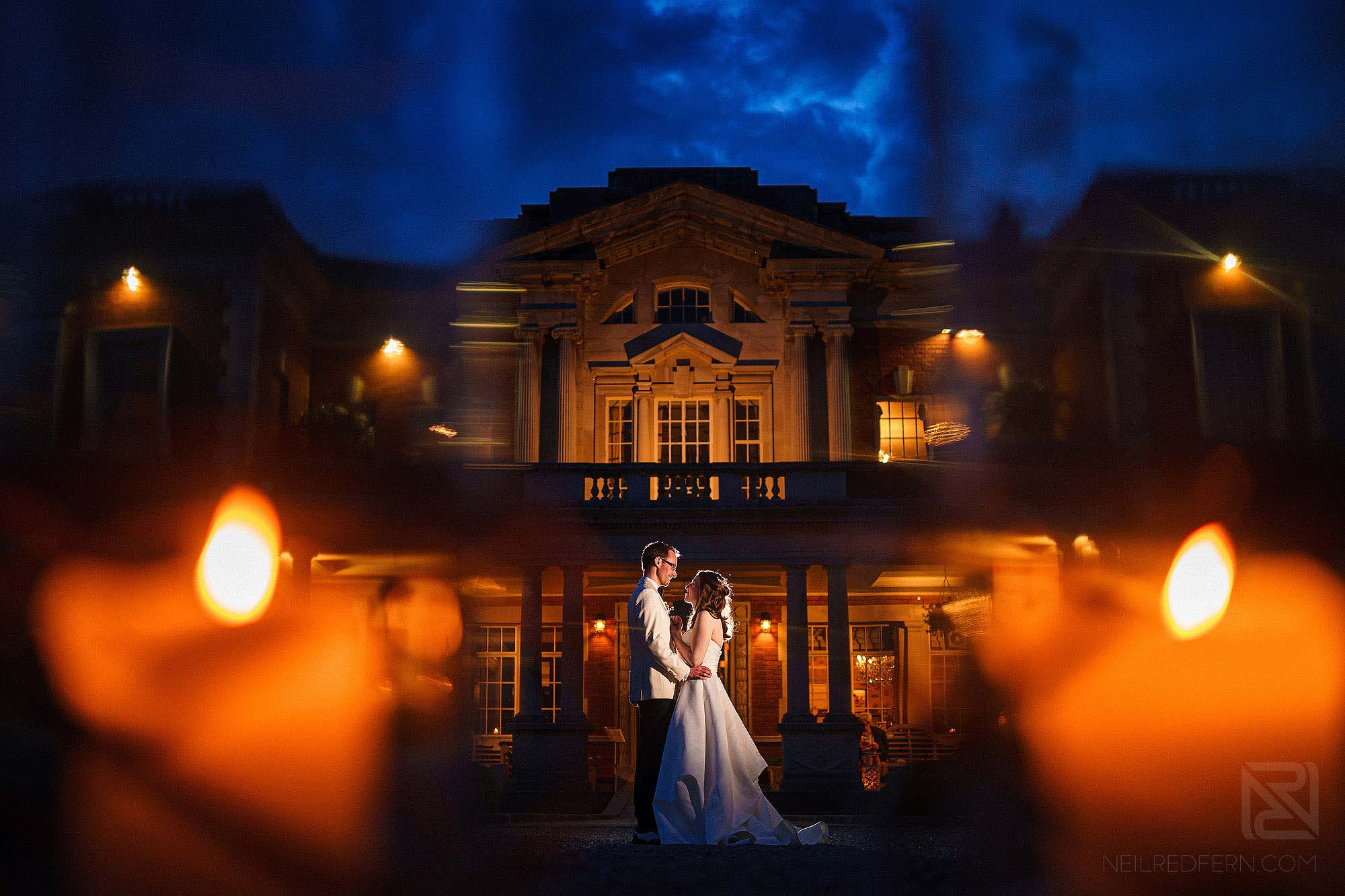off camera flash portrait of bride and groom outside Eaves Hall at night