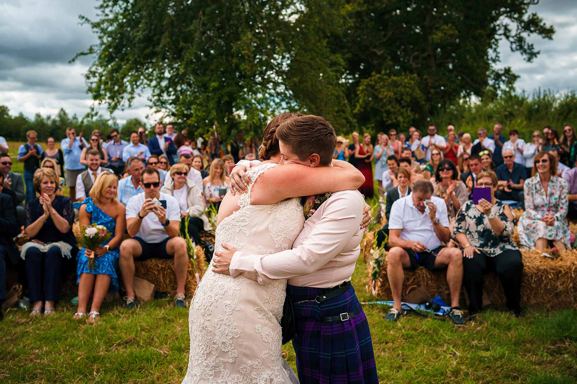 couple hugging at end of rustic wedding ceremony