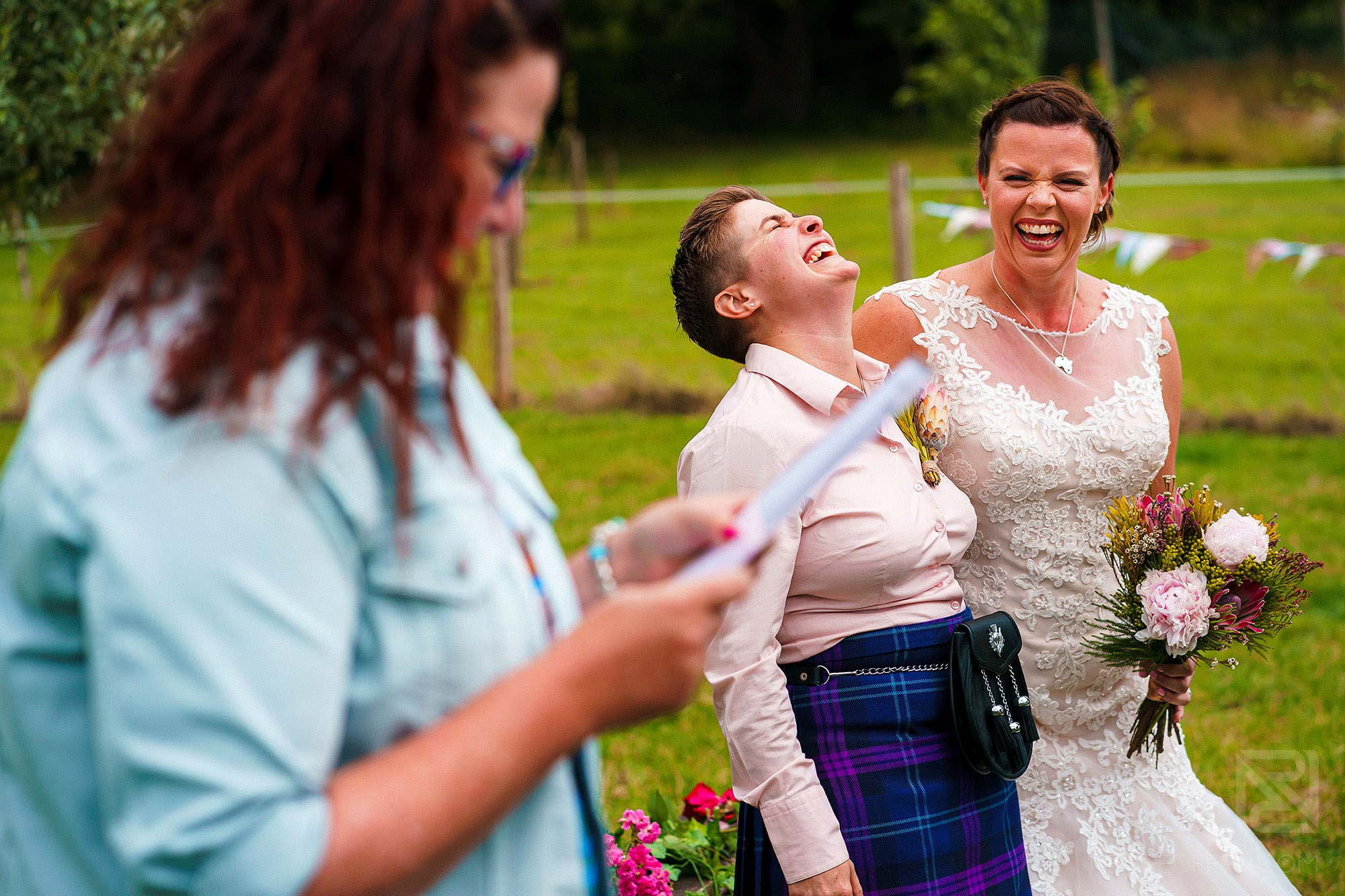 bride laughing during rustic wedding ceremony