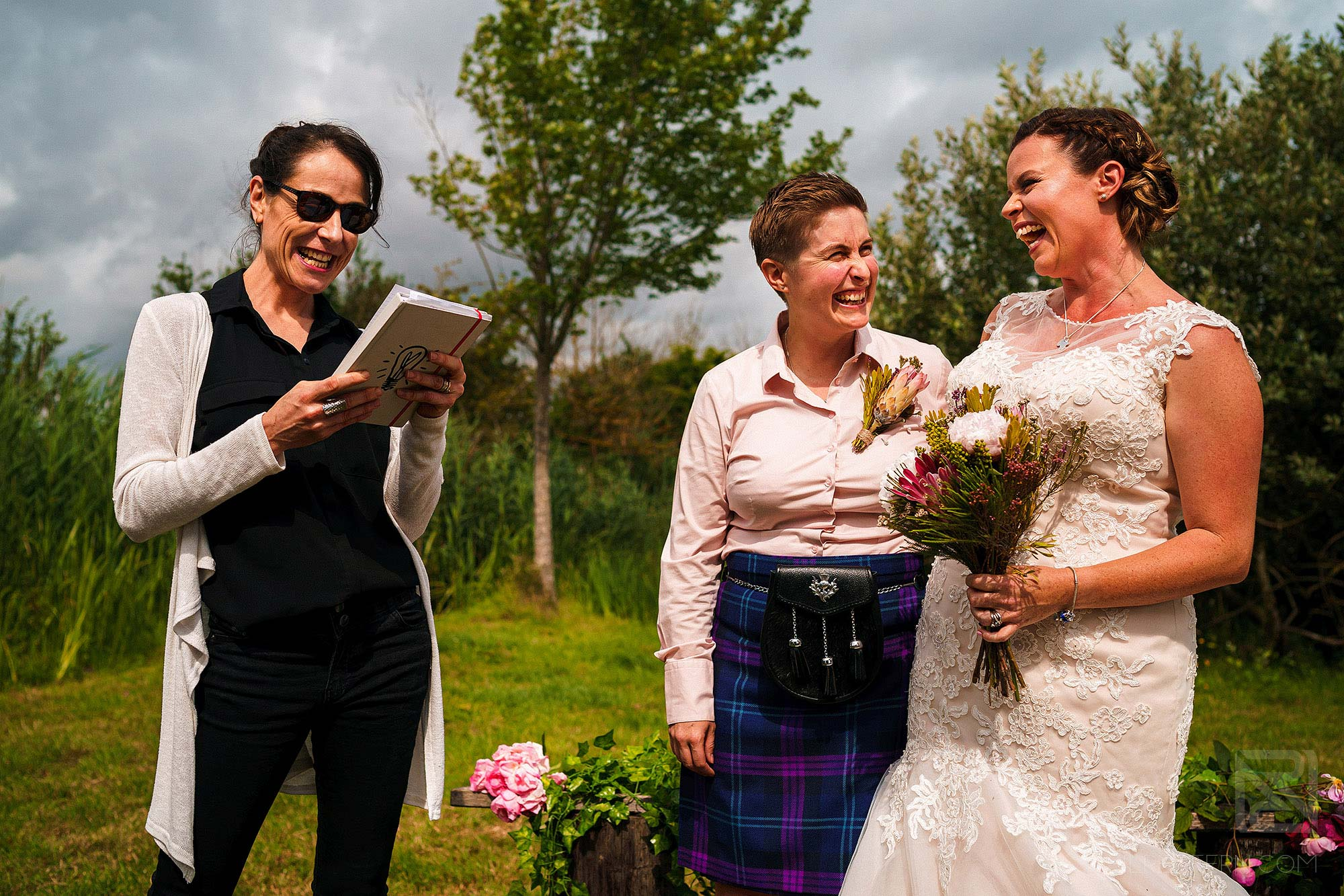 friend reading poem during outdoor rustic wedding ceremony