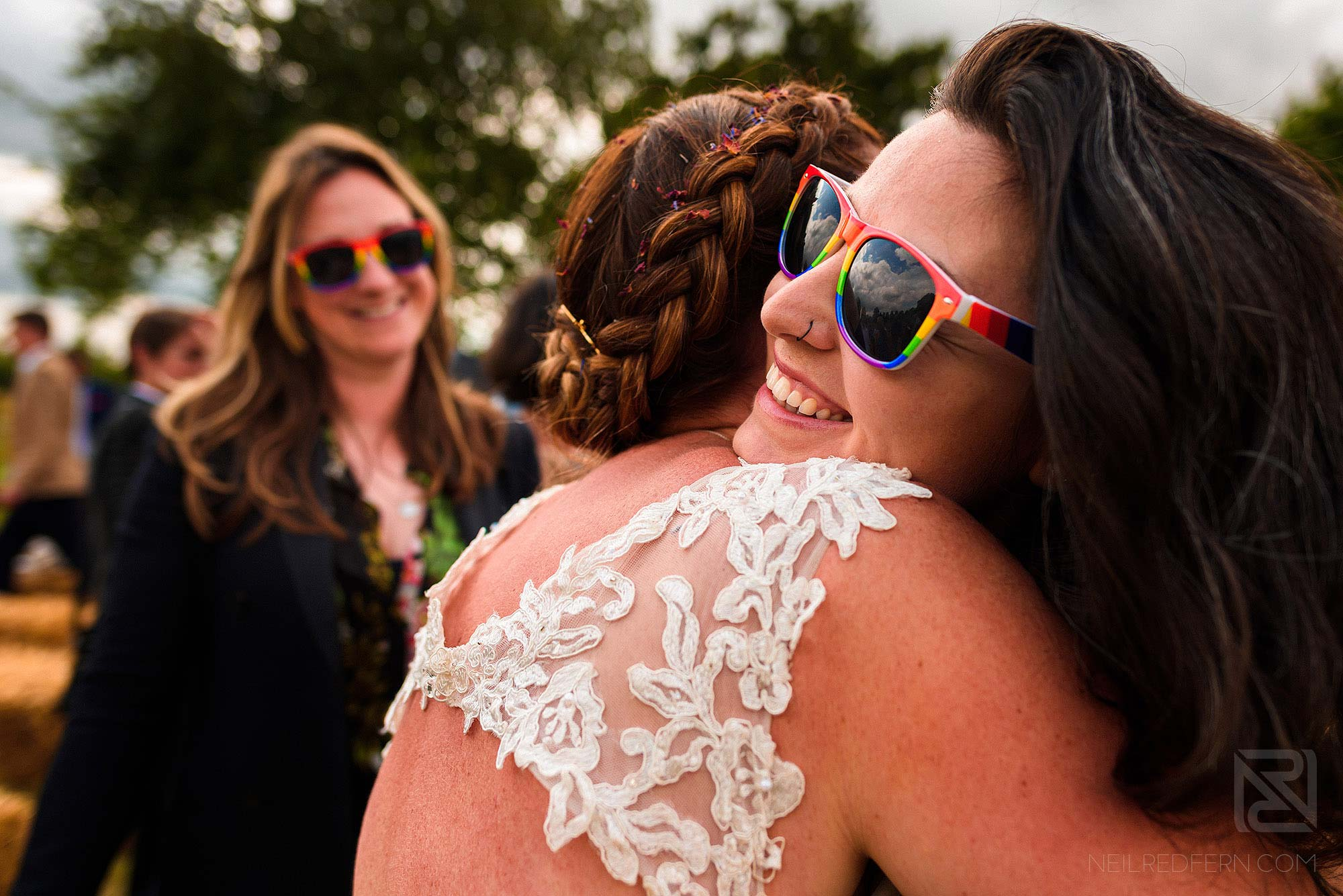 friend hugging bride