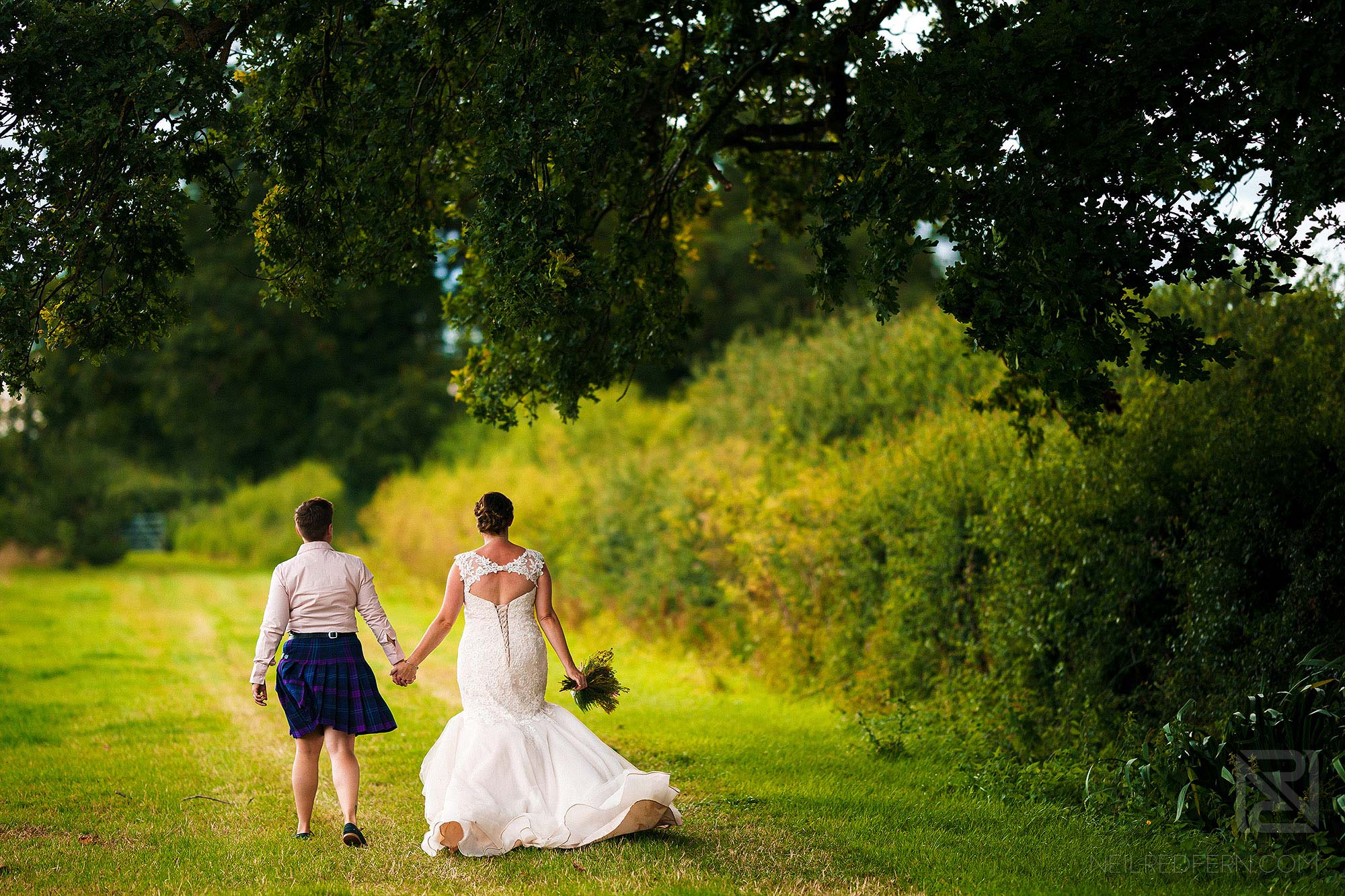 newlywed brides walking away from camera