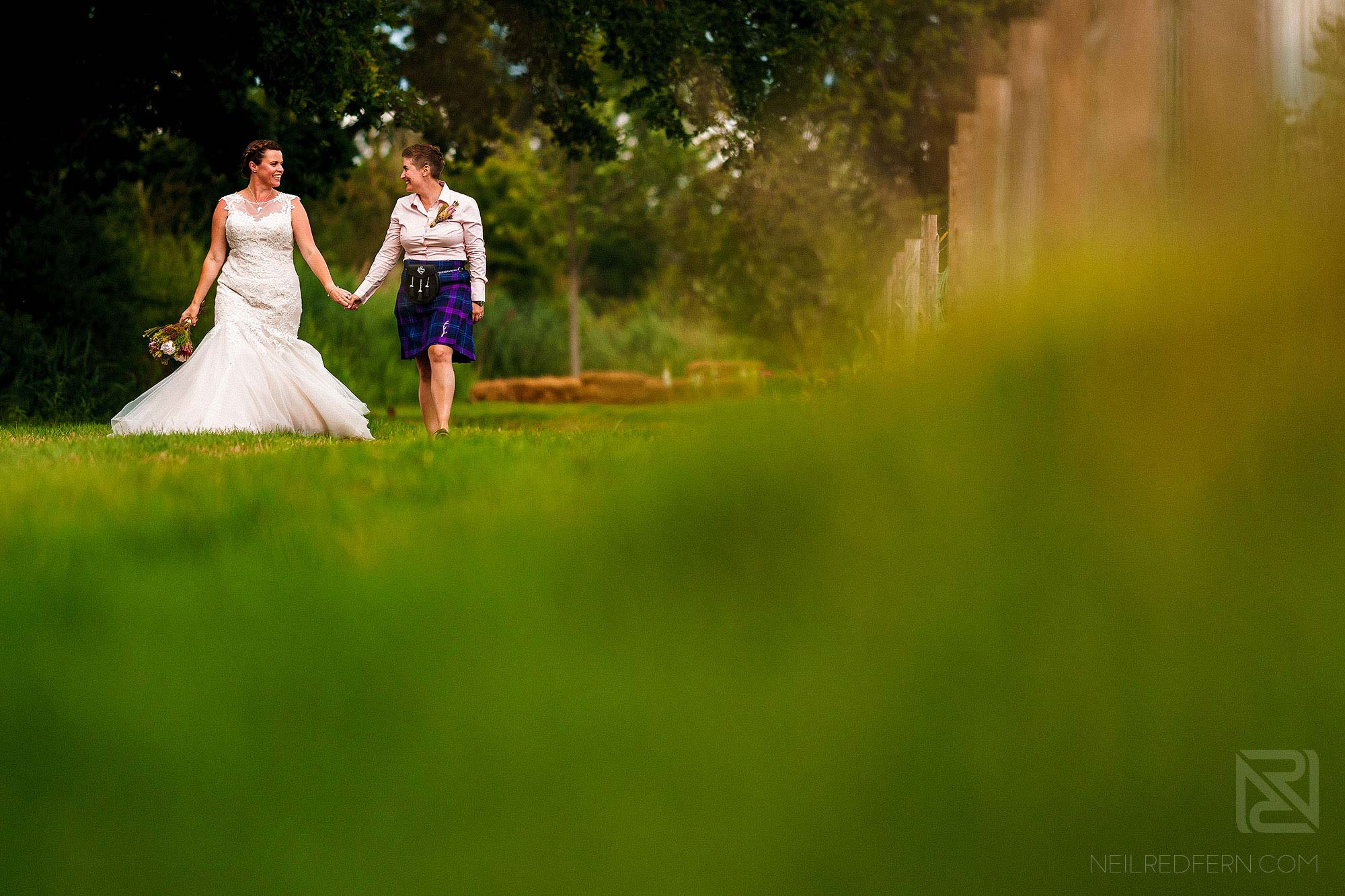 brides walking through countryside together