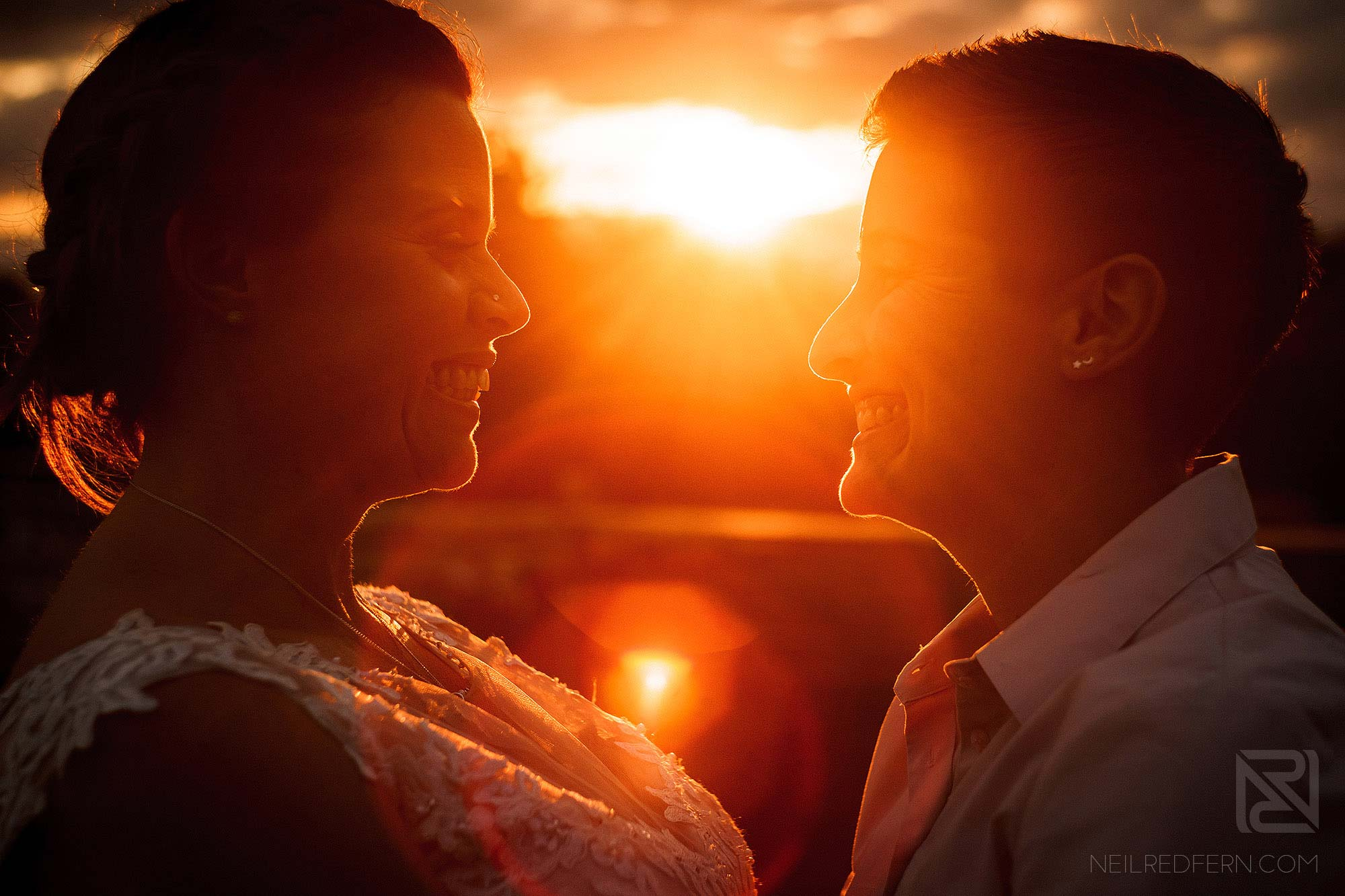 beautiful photograph of two brides at sunset