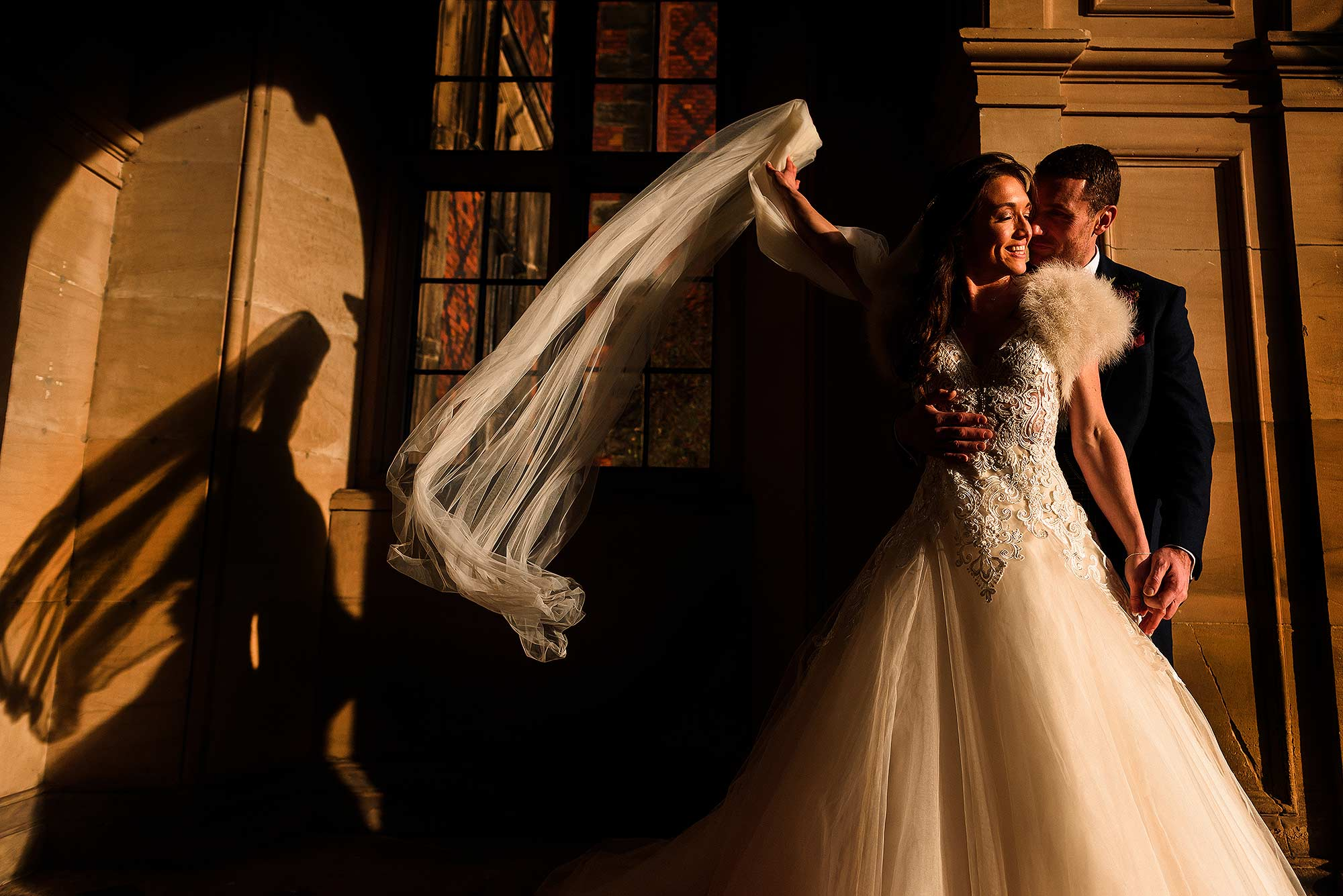 natural portrait of bride and groom in late evening sunlight at Arley Hall in Cheshire