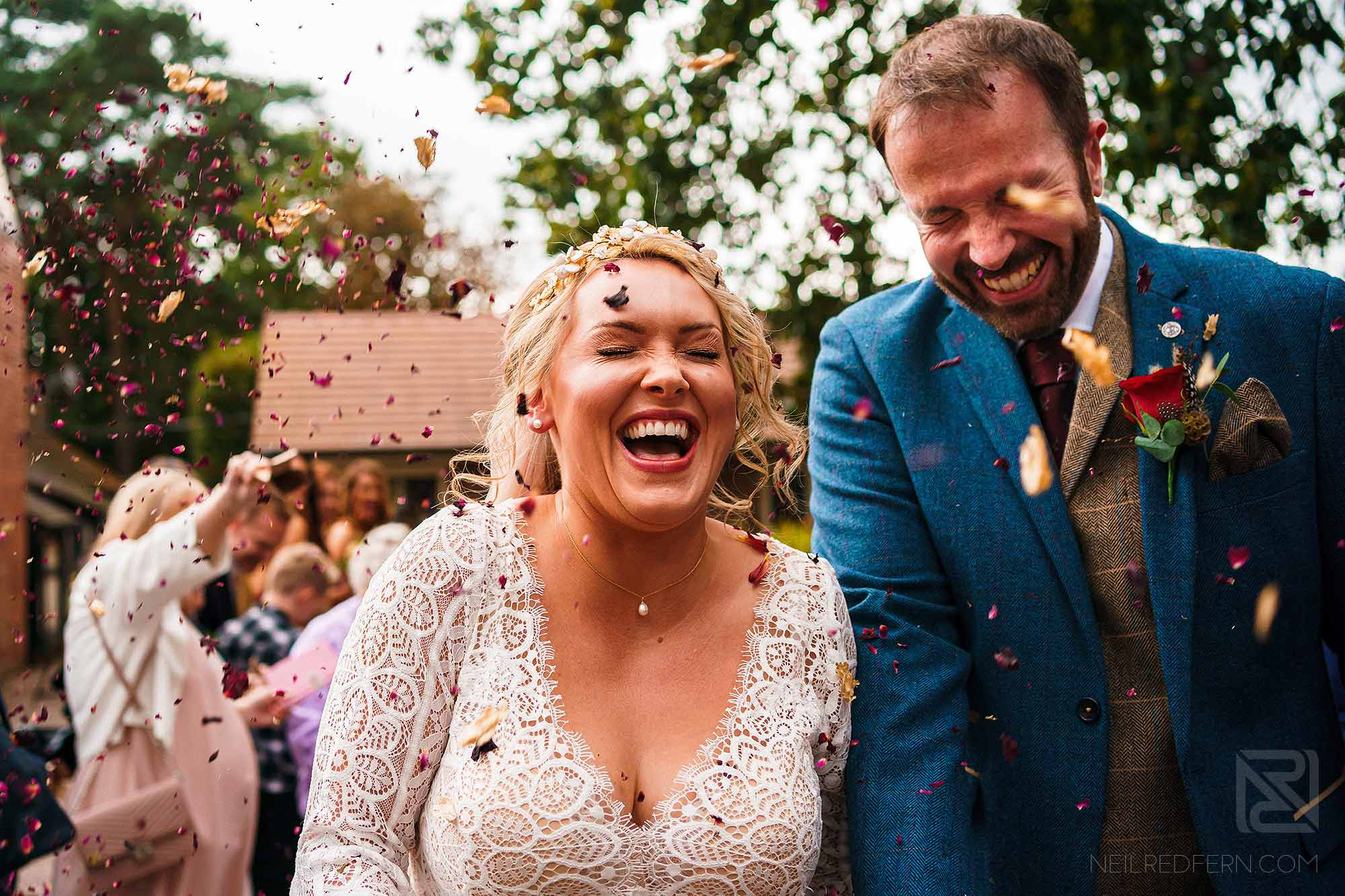 confetti being thrown over bride and groom at Abbeywood Estate in Cheshire