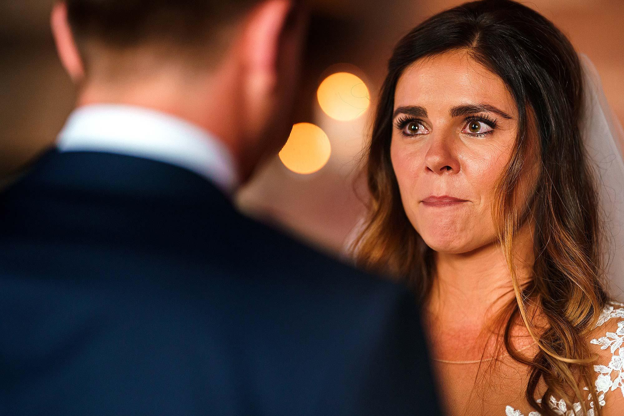 bride getting emotional during wedding ceremony at Peckforton castle