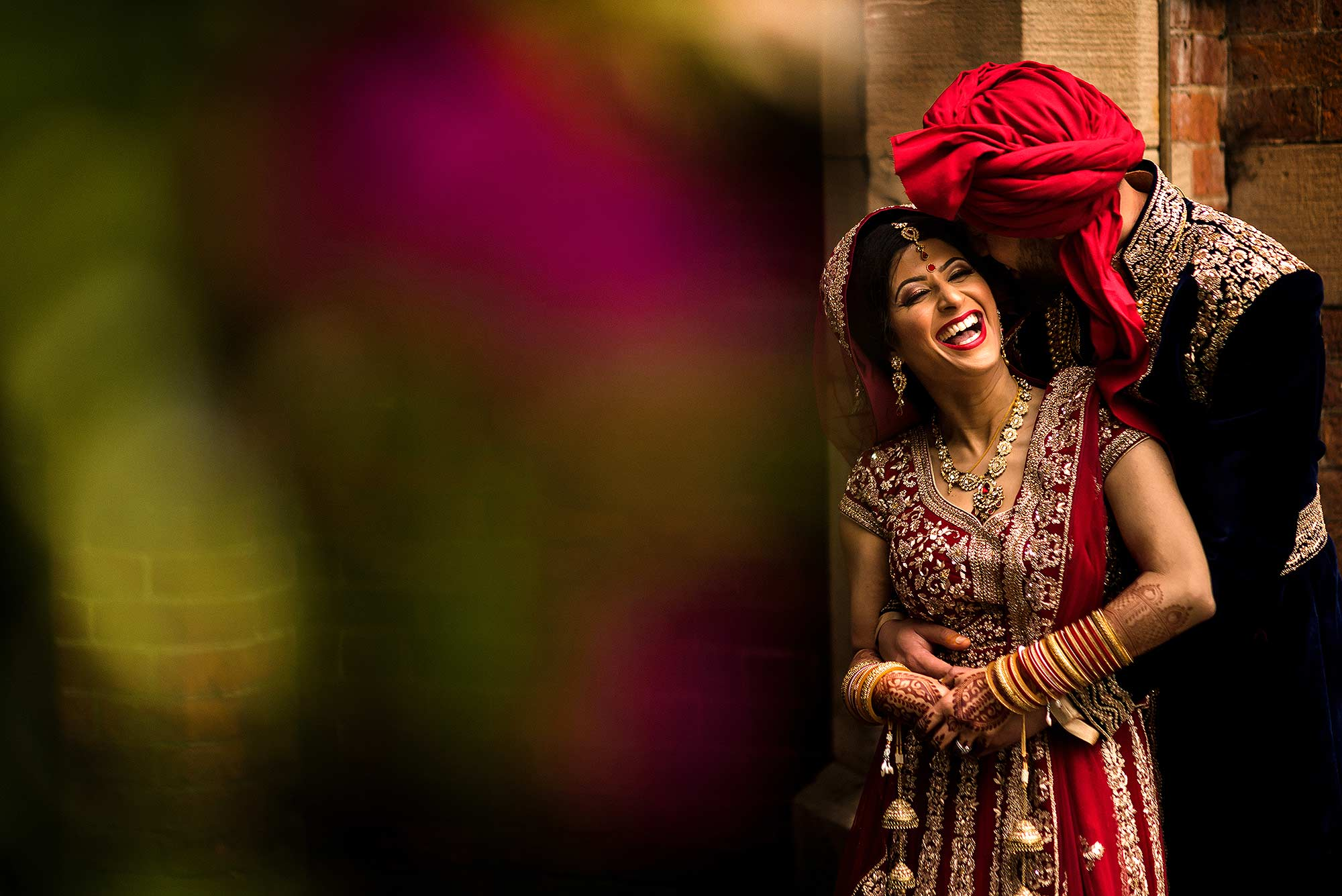 fun relaxed portrait of Indian Bride and Groom laughing