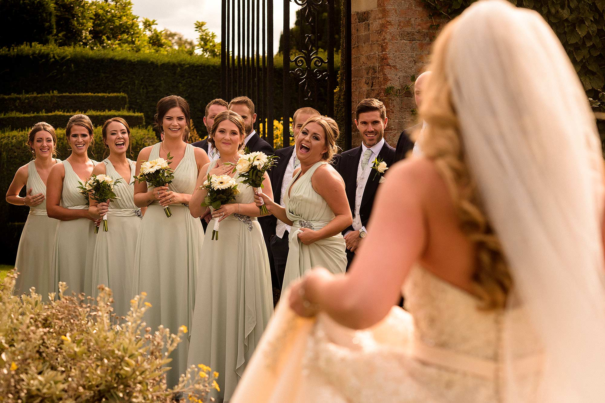 genuine fun photograph of bride walking towards bridesmaids