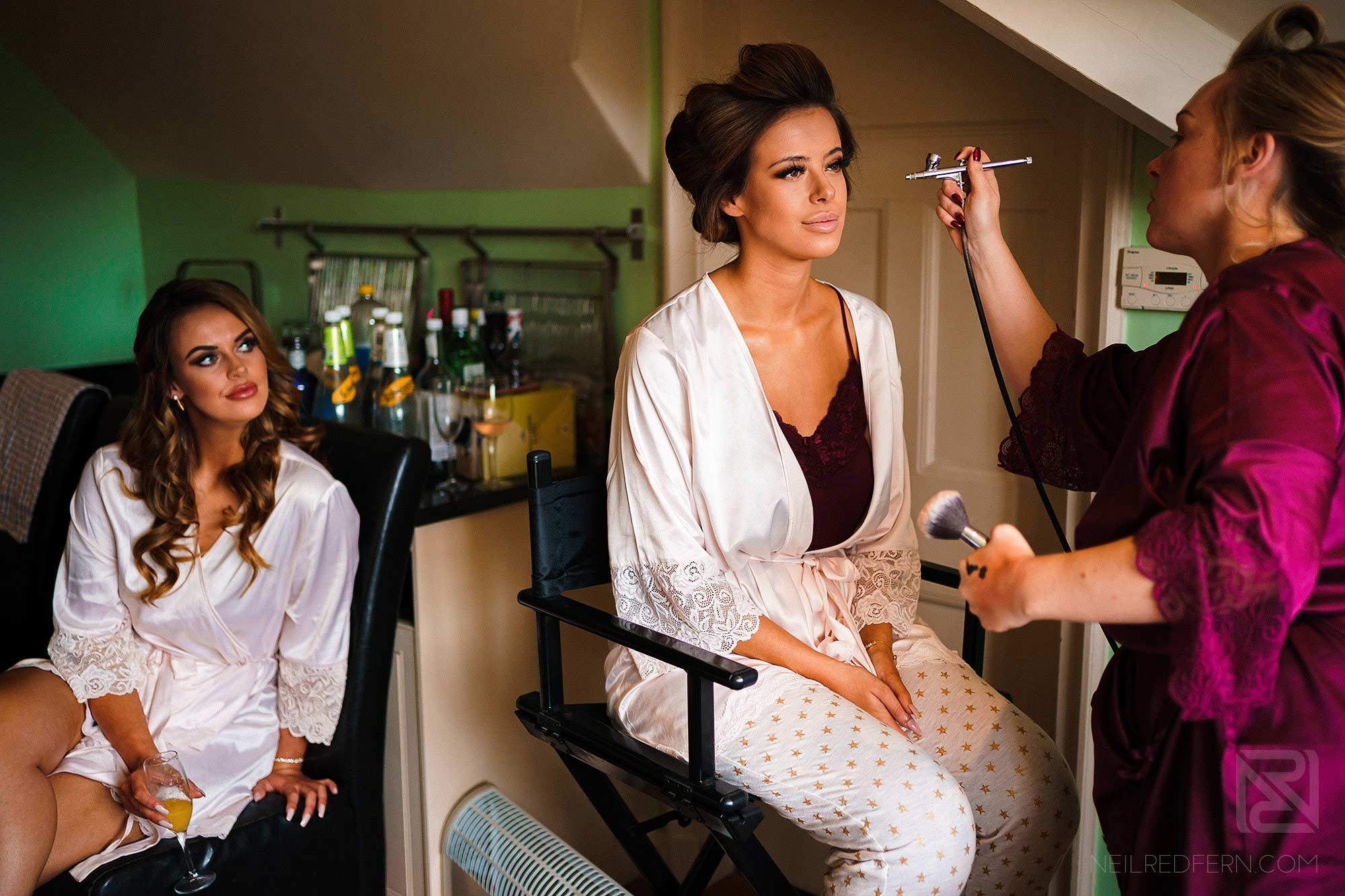 bridemaids getting ready on morning of wedding at Abbeywood Estate