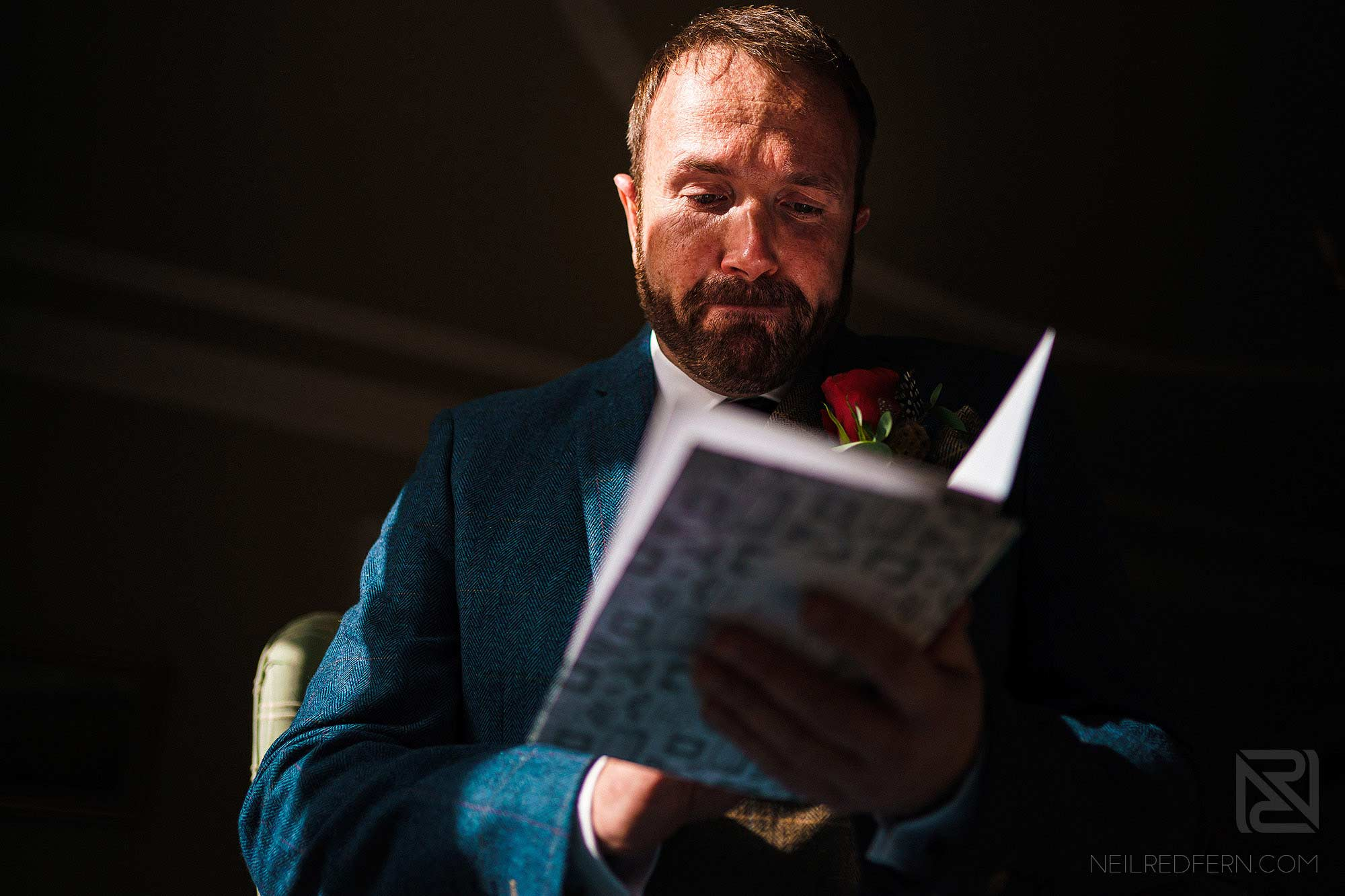 emotional groom reading card from bride