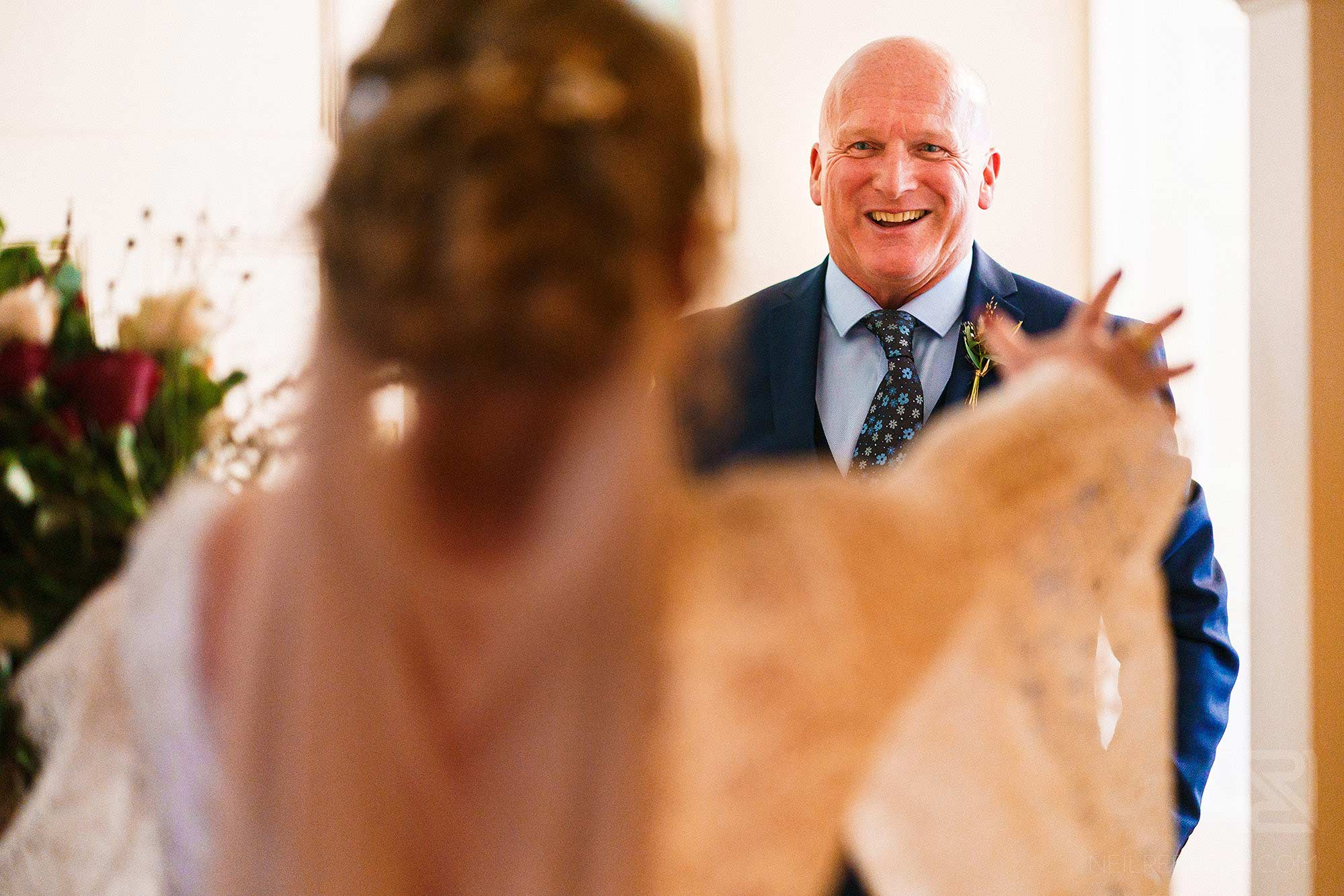 father seeing daughter in wedding dress for first time