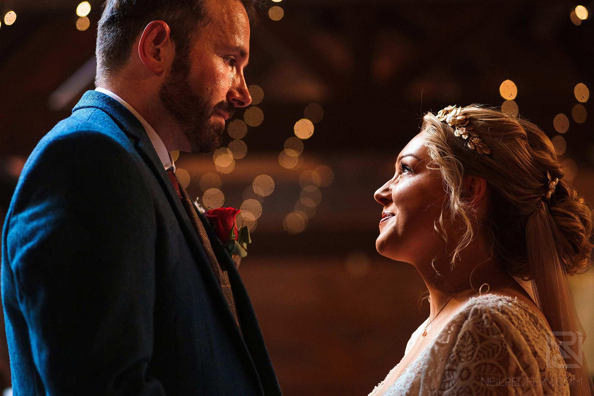 heartfelt look between bride and groom during Abbeywood Estate wedding ceremony