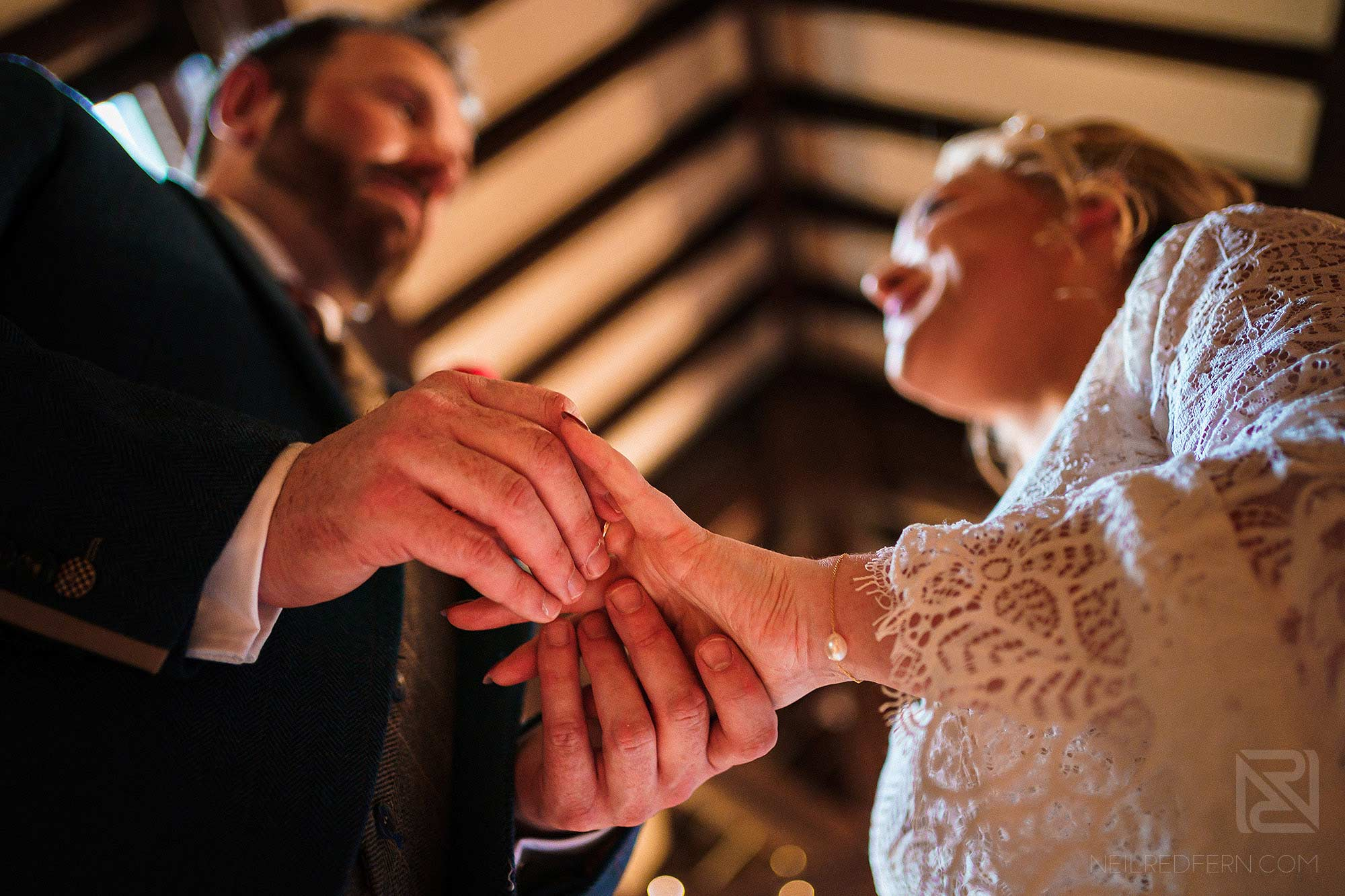 creative photograph of bride and groom exchanging wedding rings