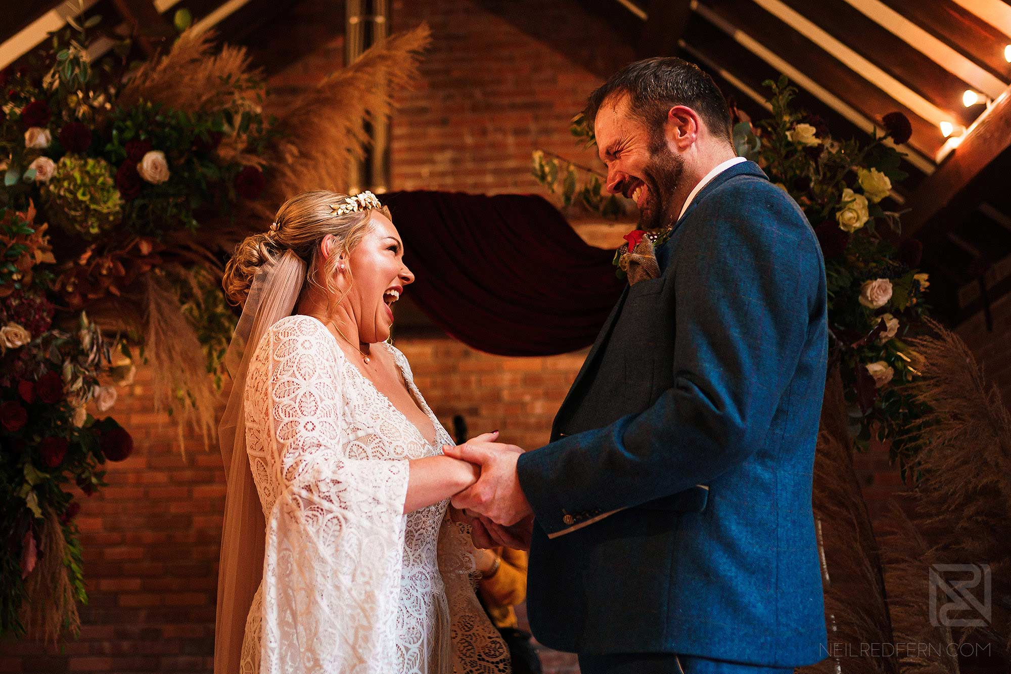 happy moment during wedding ceremony at Abbeywood Estate in Cheshire