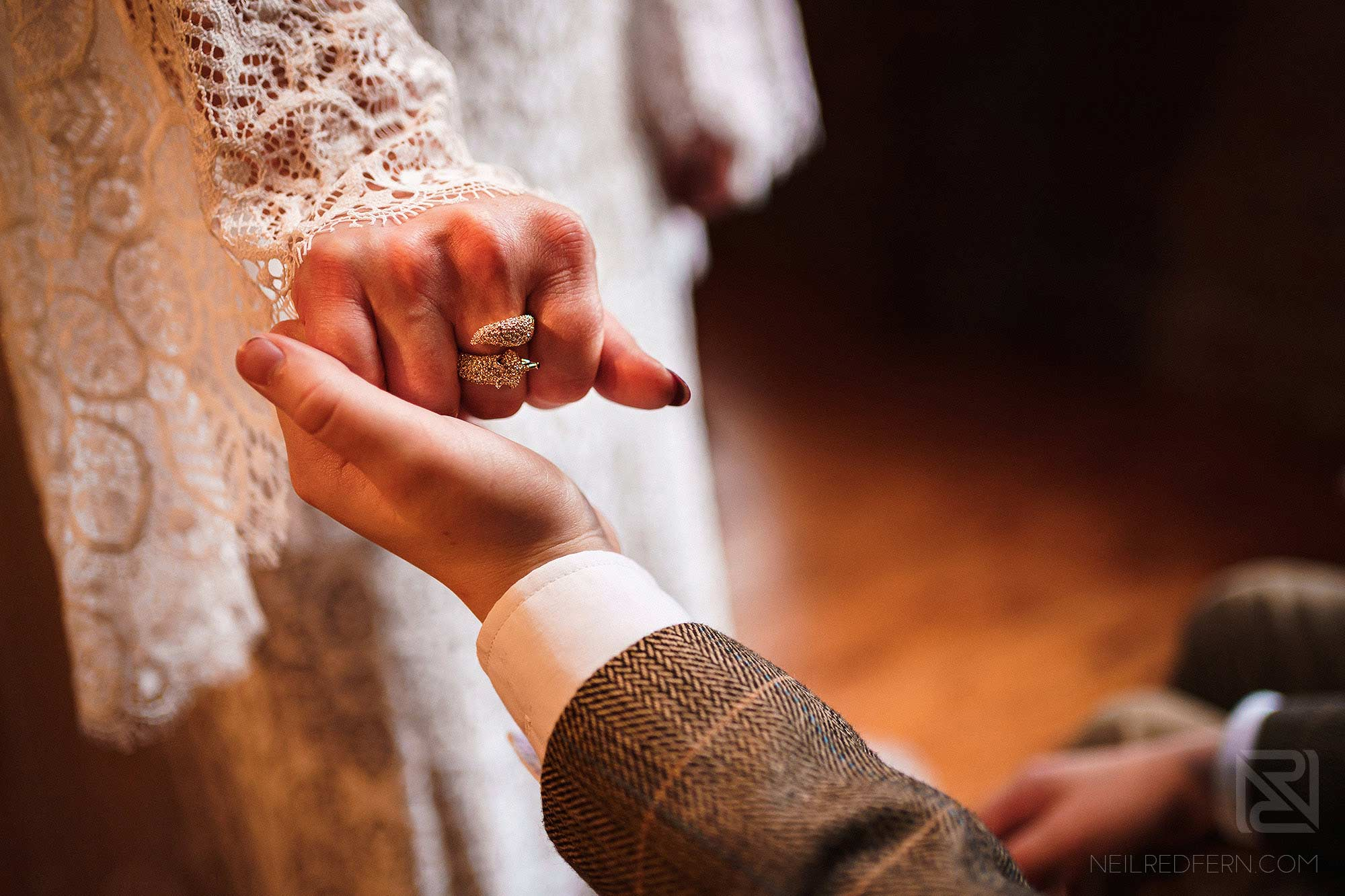 documentary photograph of bride holding son's hand