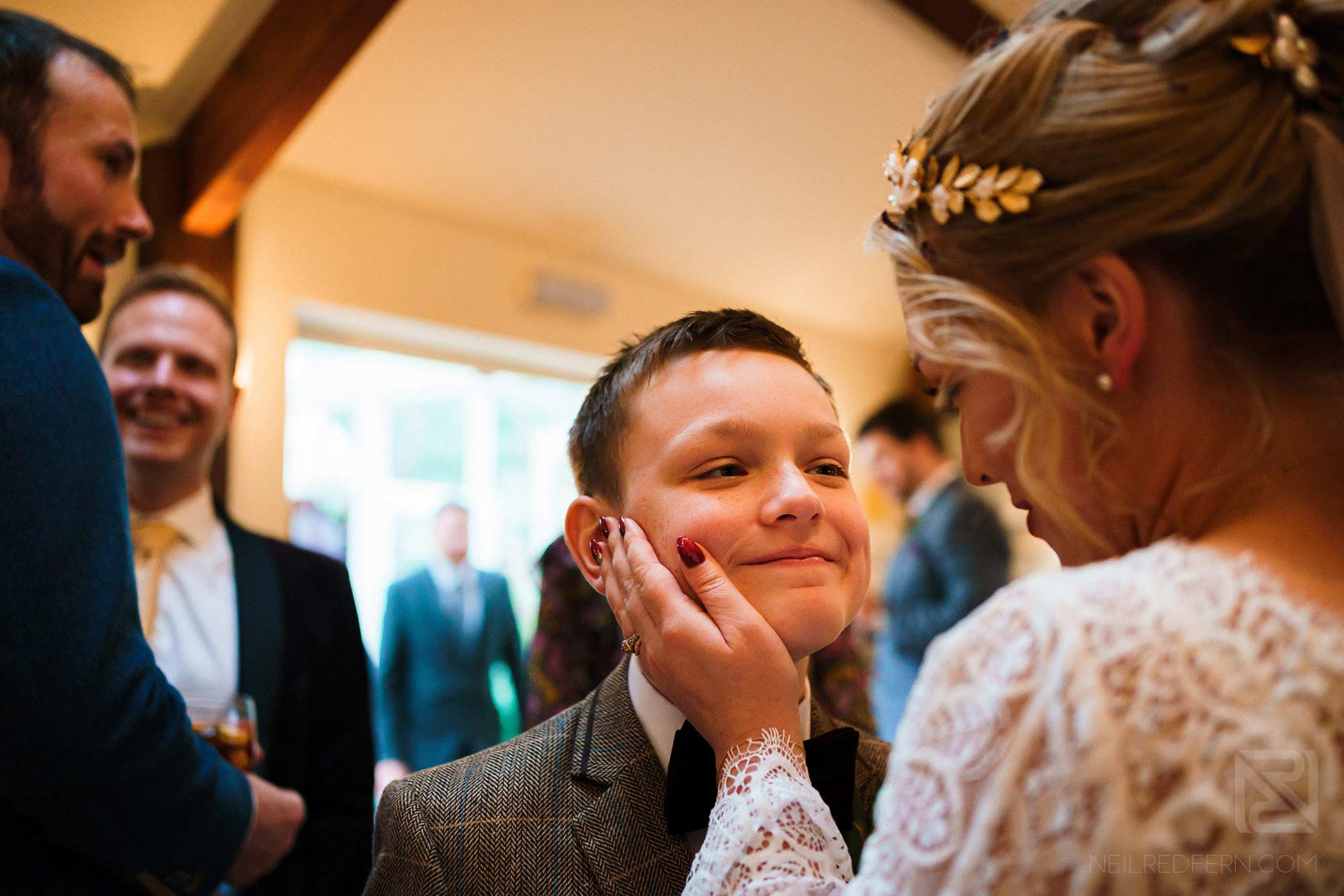 tender moment between bride and son during drinks reception