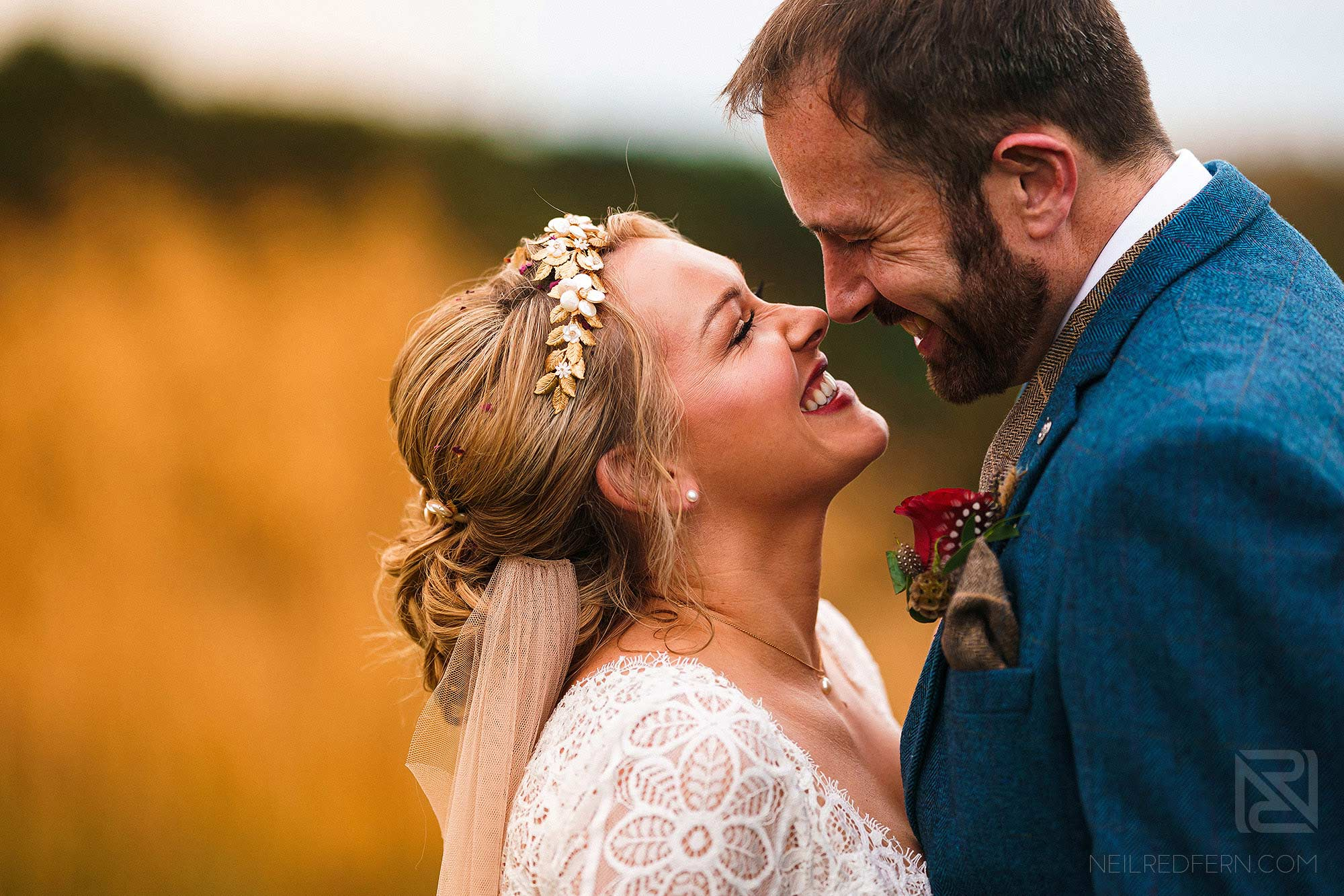natural light portrait of bride and groom smiling
