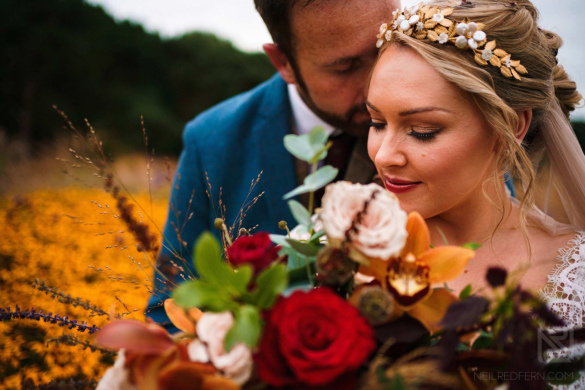 beautiful portrait of bride and groom holding bouquet