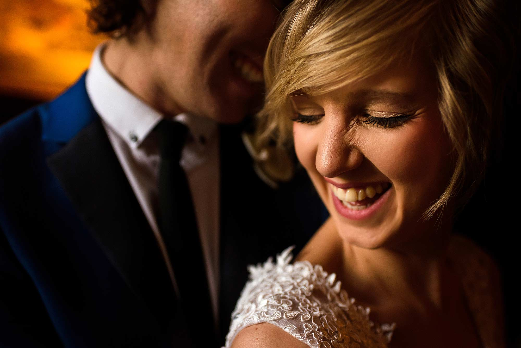 natural portrait of bride and groom laughing in Eaves Hall