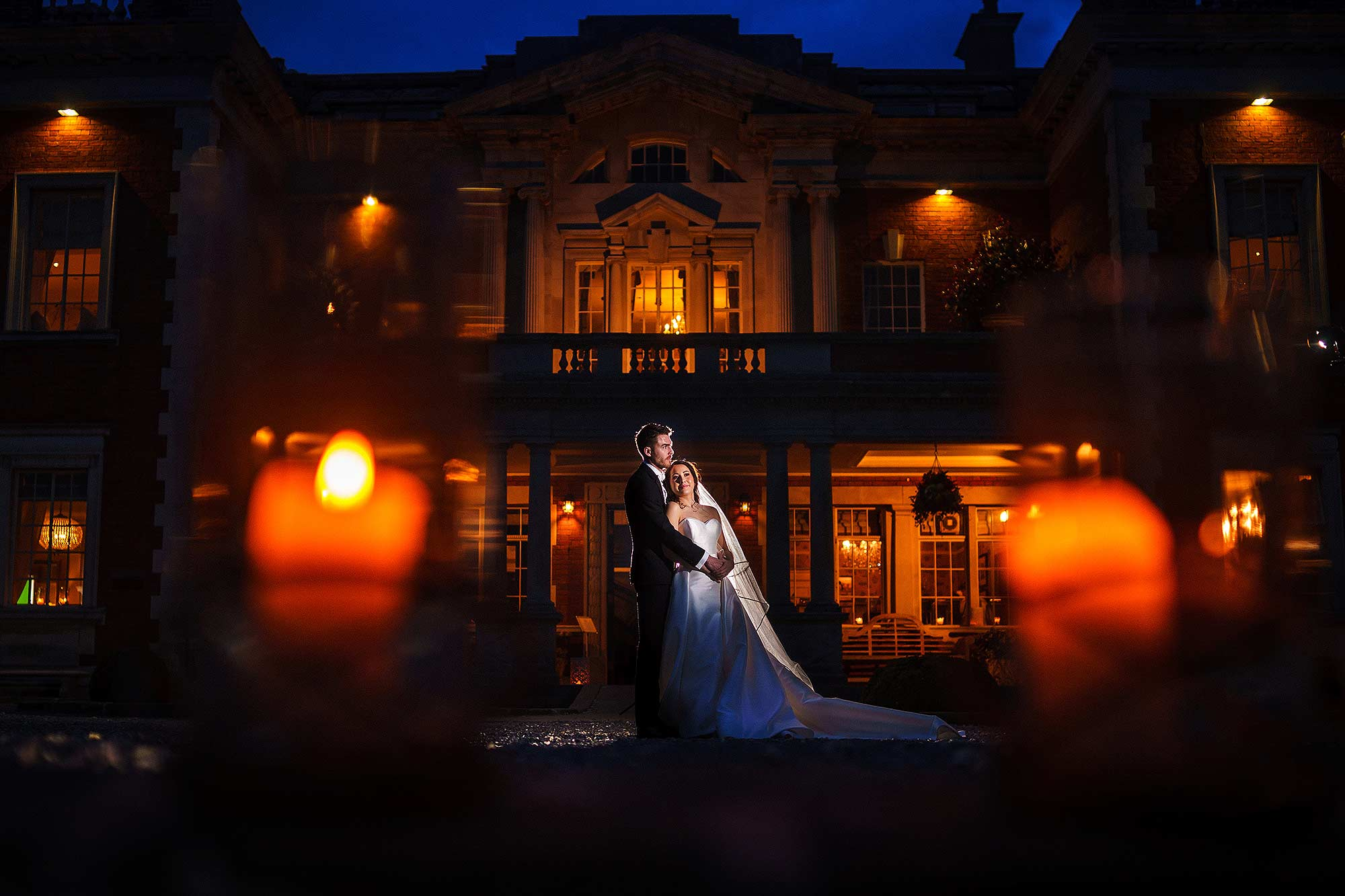creative off camera portrait of bride and groom outside Eaves Hall in Lancashire