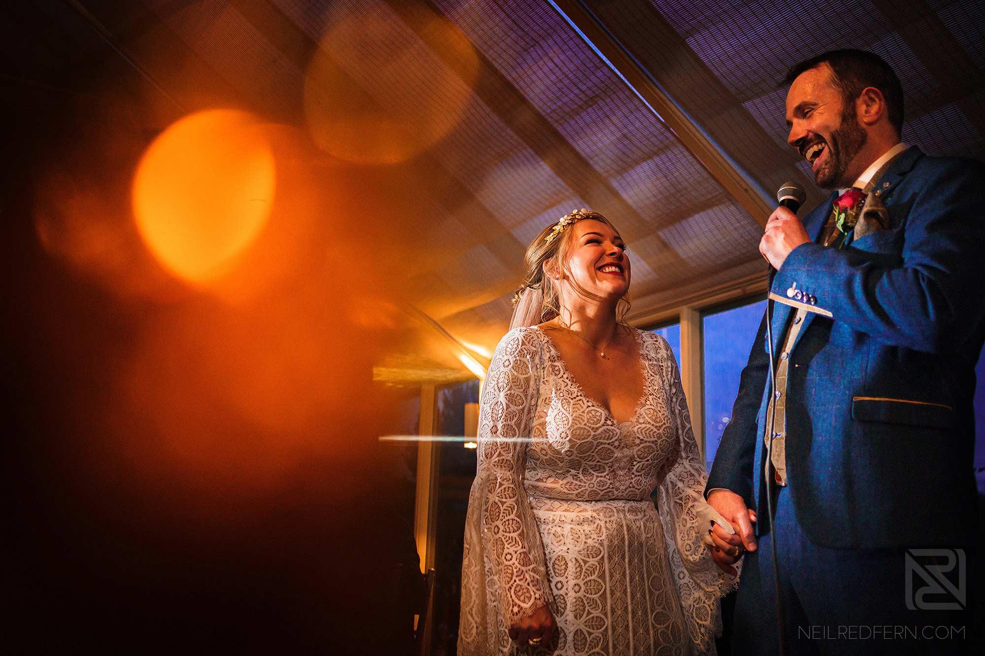 bride and groom giving wedding speech
