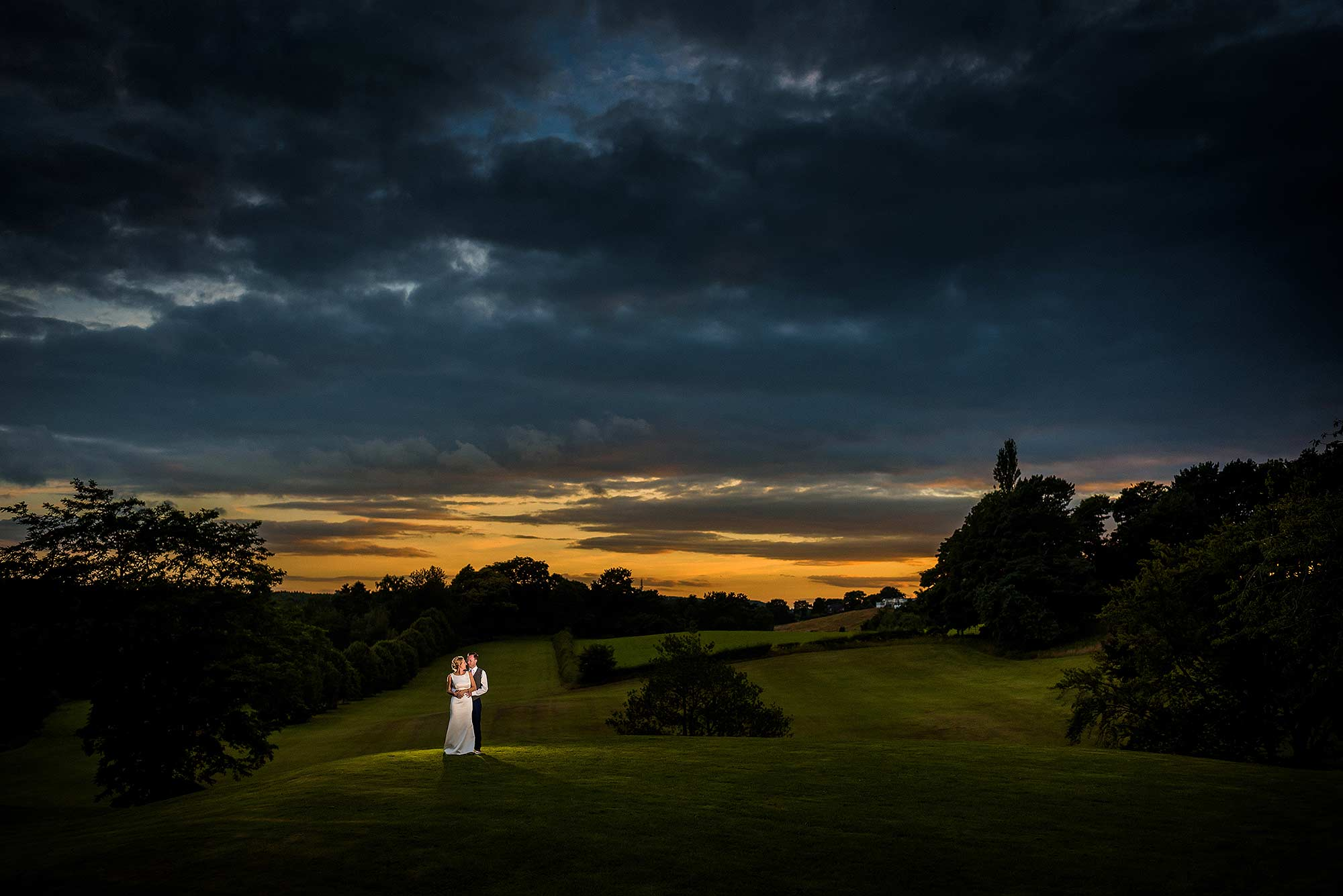 wide angle off camera flash portrait of bride and groom in Cheshire