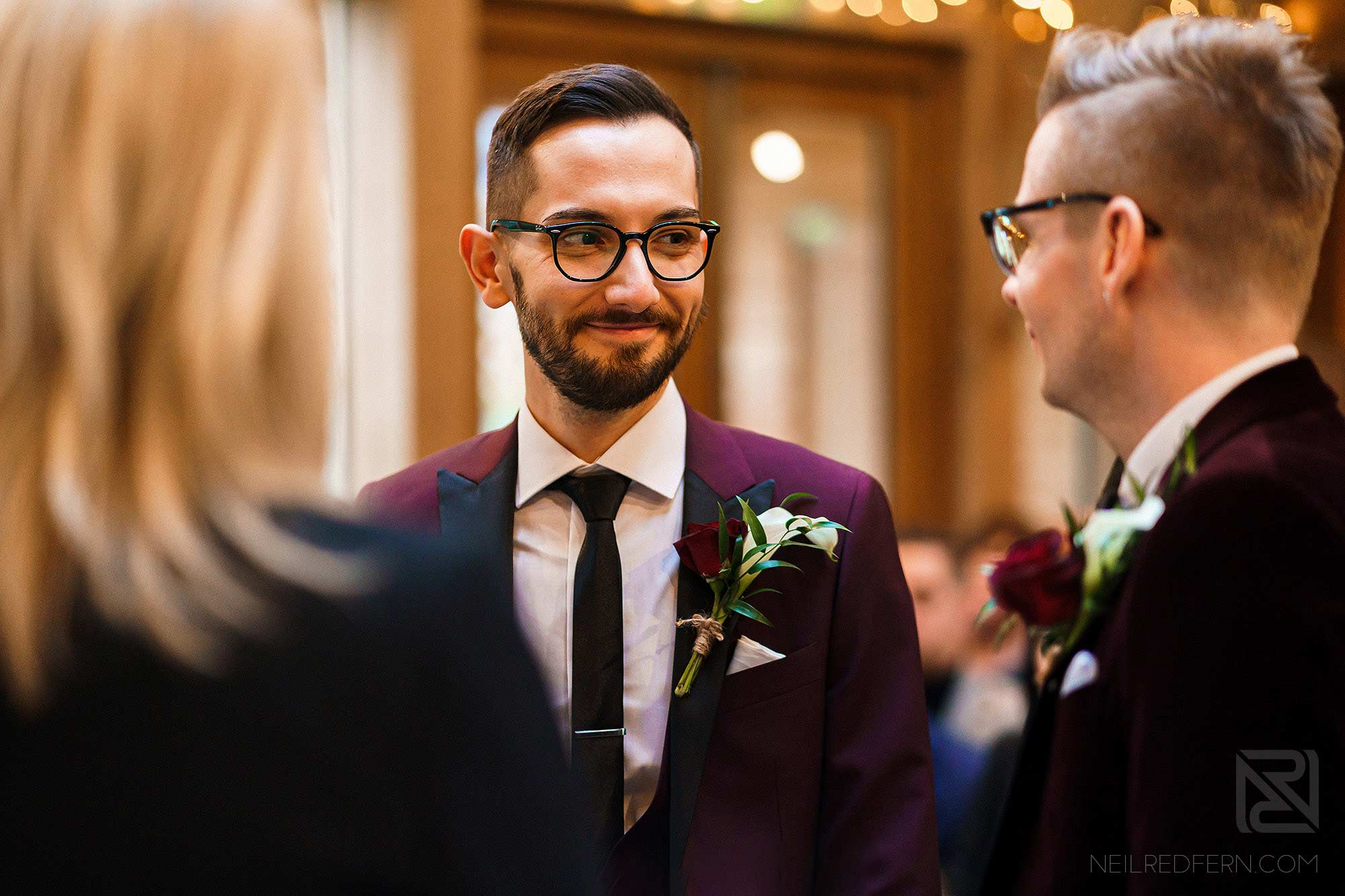 grooms looking at each other during wedding ceremony