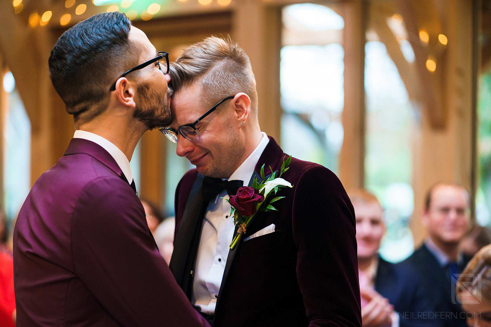 emotional moment between two grooms
