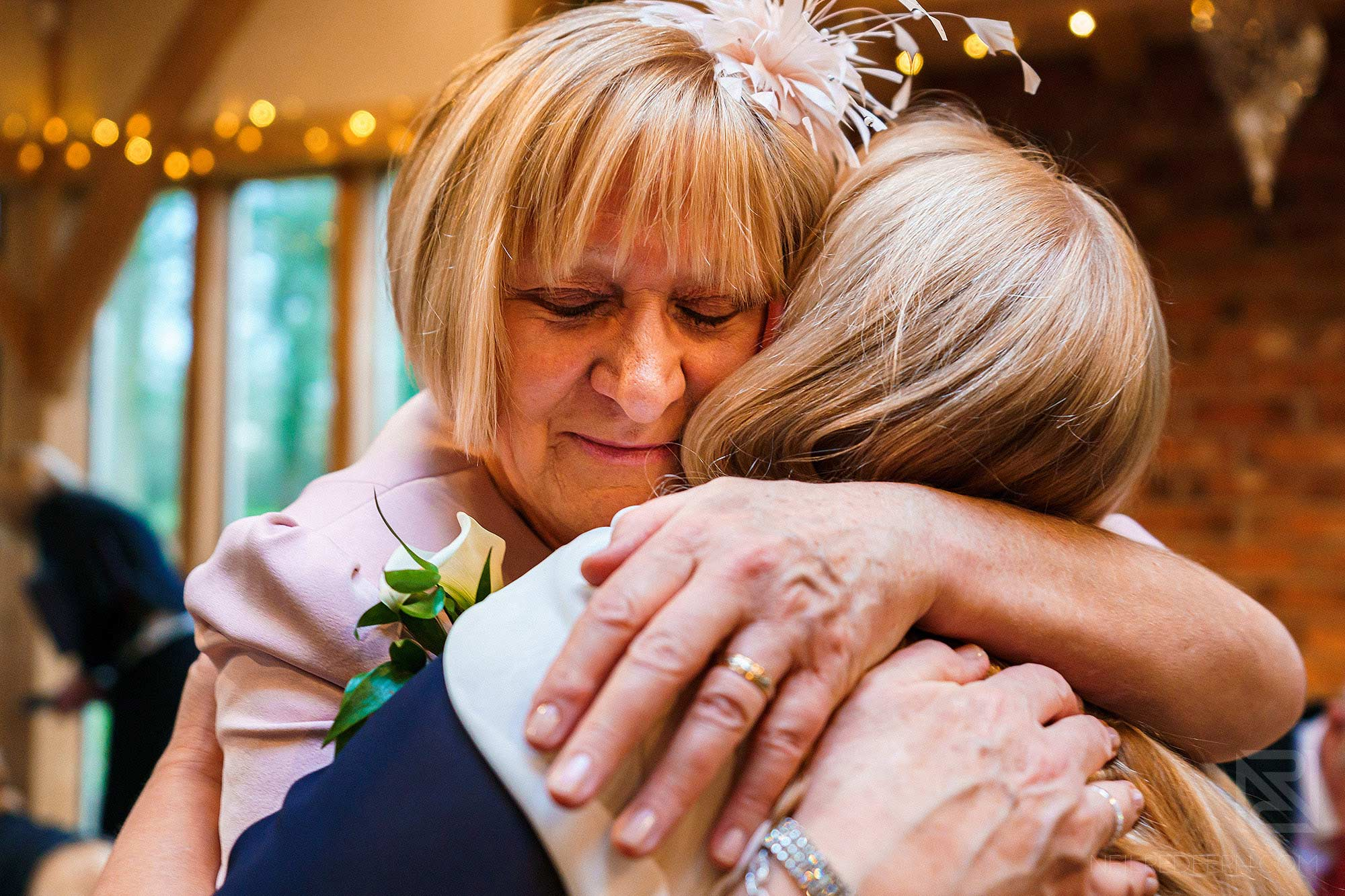 two mums hugging each other at the Oak Tree of Peover