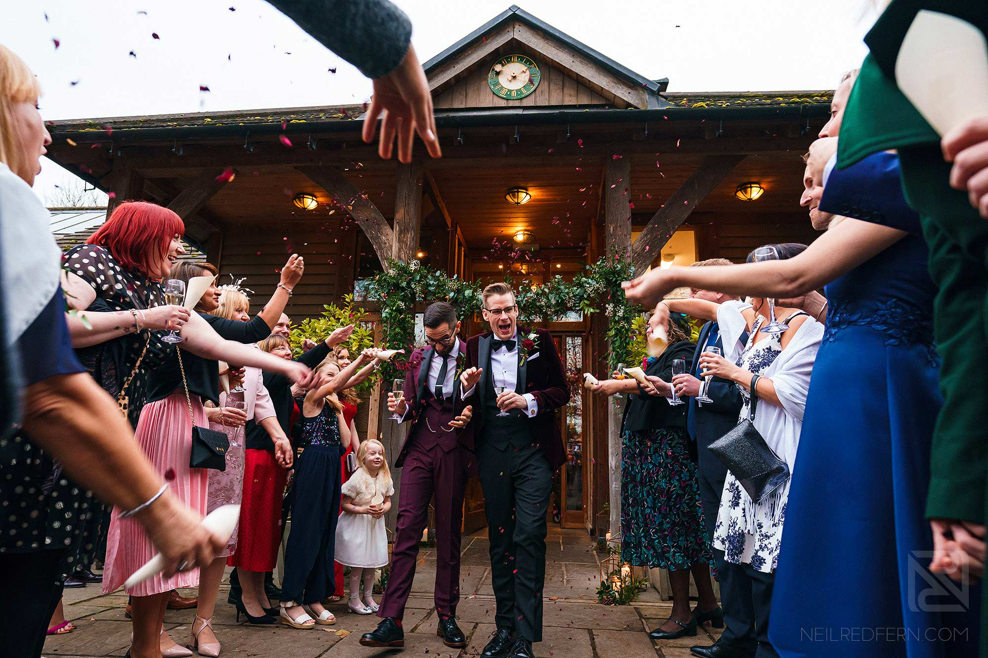 wedding guests throwing confetti outside the Oak Tree of Peover