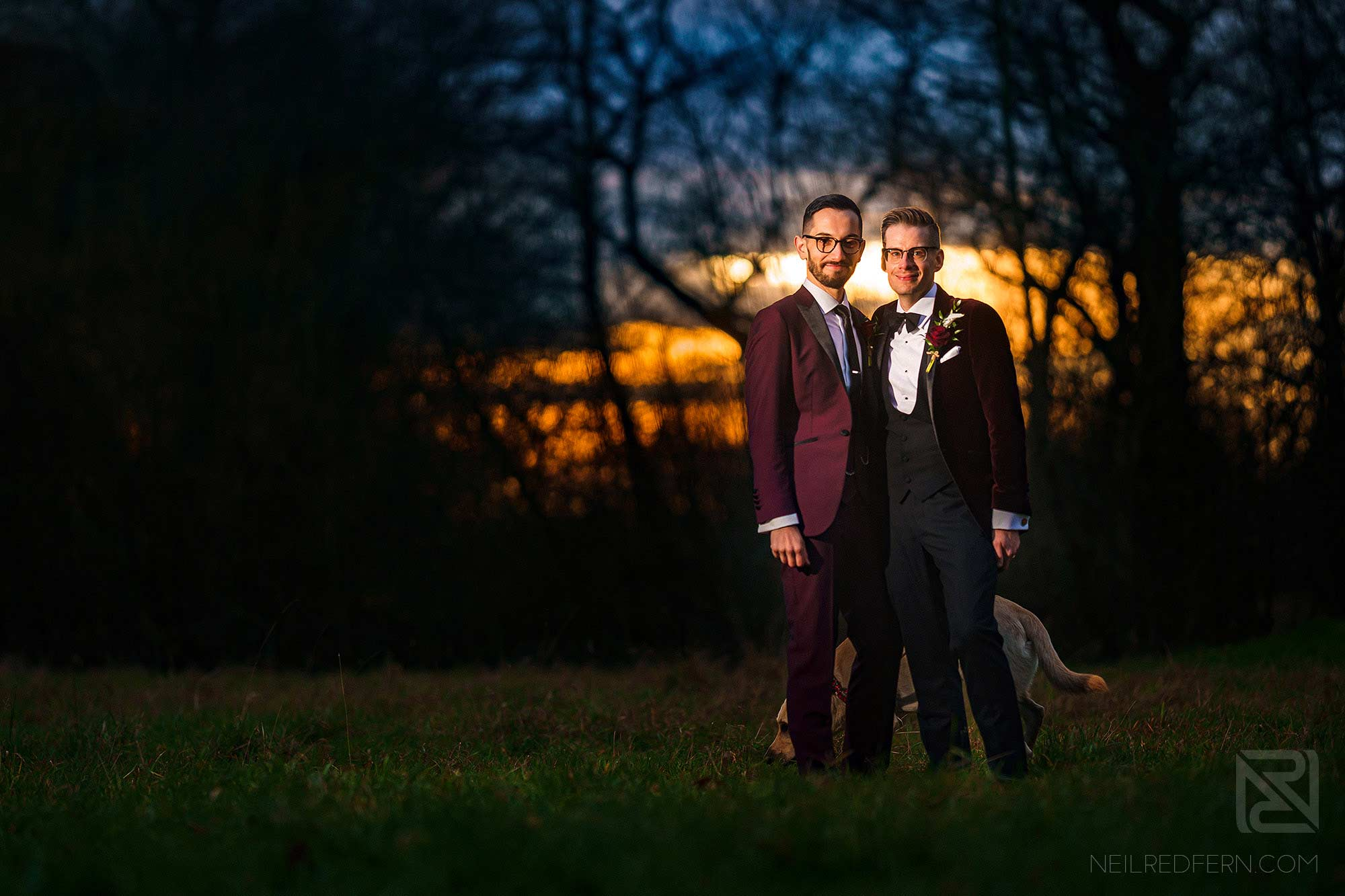 sunset of two grooms at the Oak Tree of Peover winter wedding