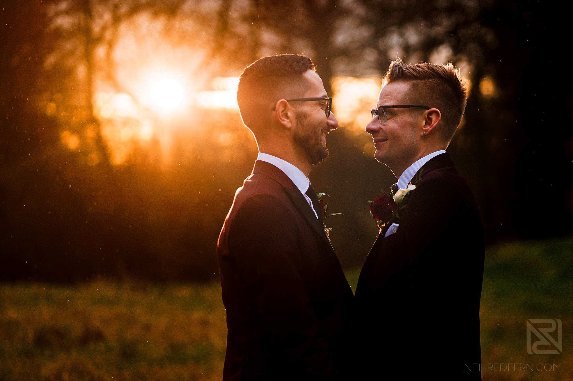 sunset photograph of two grooms
