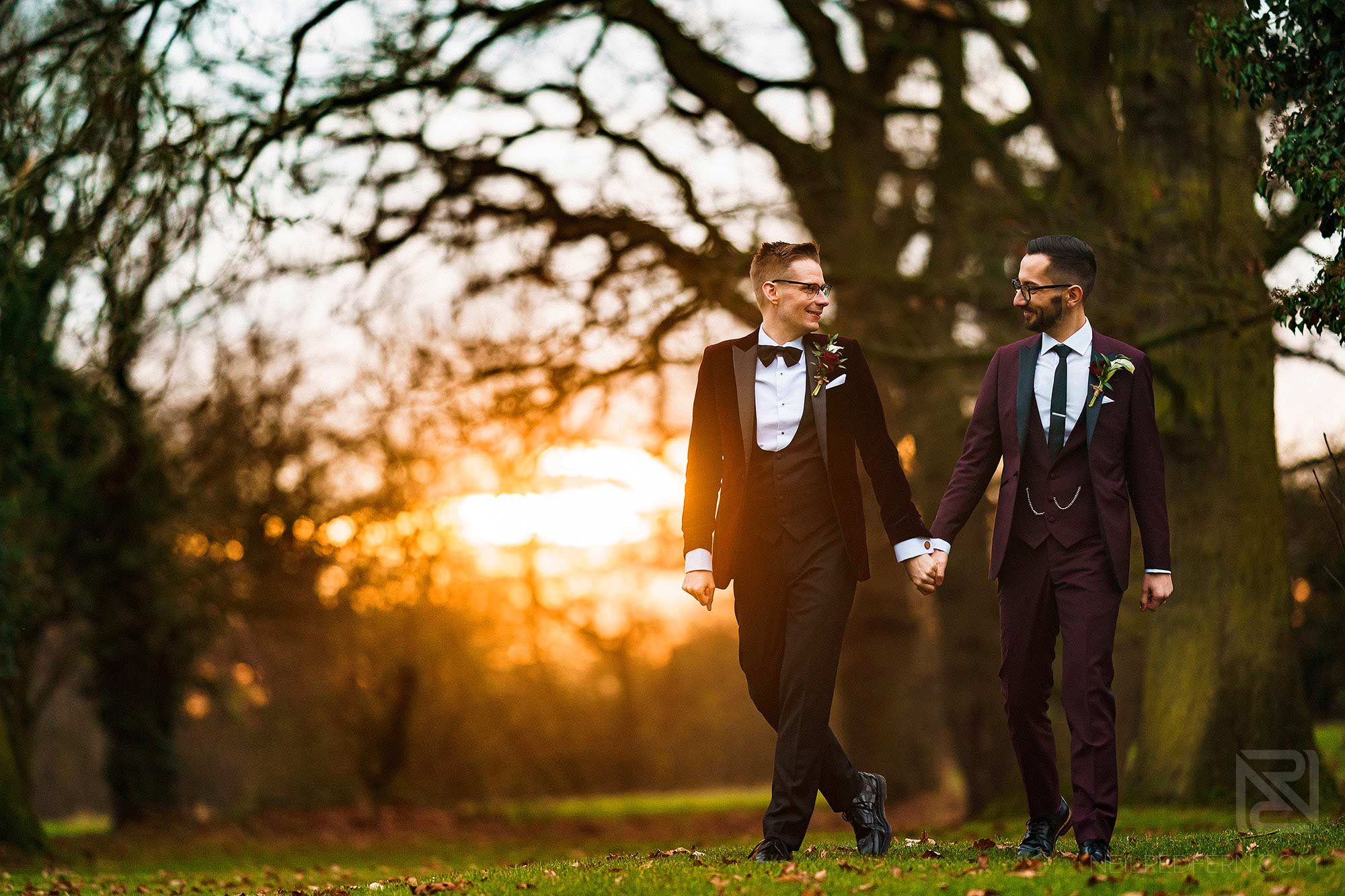 sunset photograph of two grooms walking