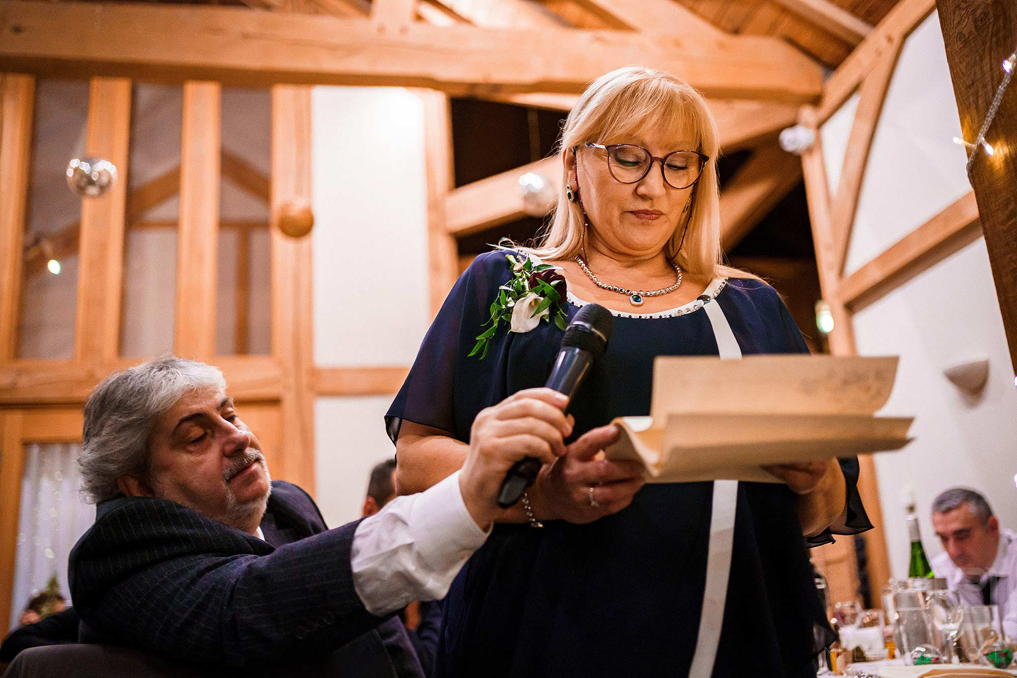 mother of groom reading out speech during wedding breakfast