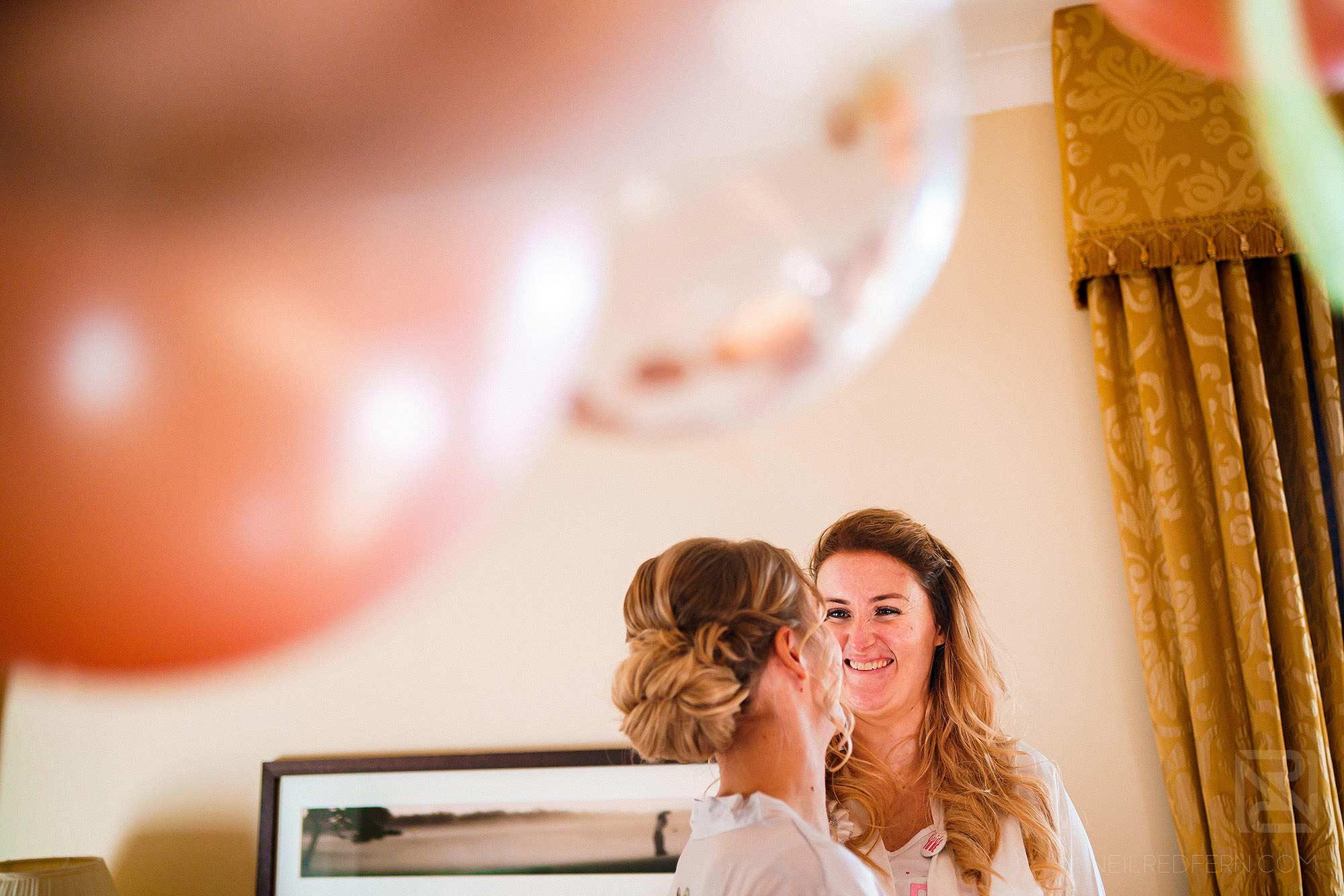 girls laughing on wedding morning