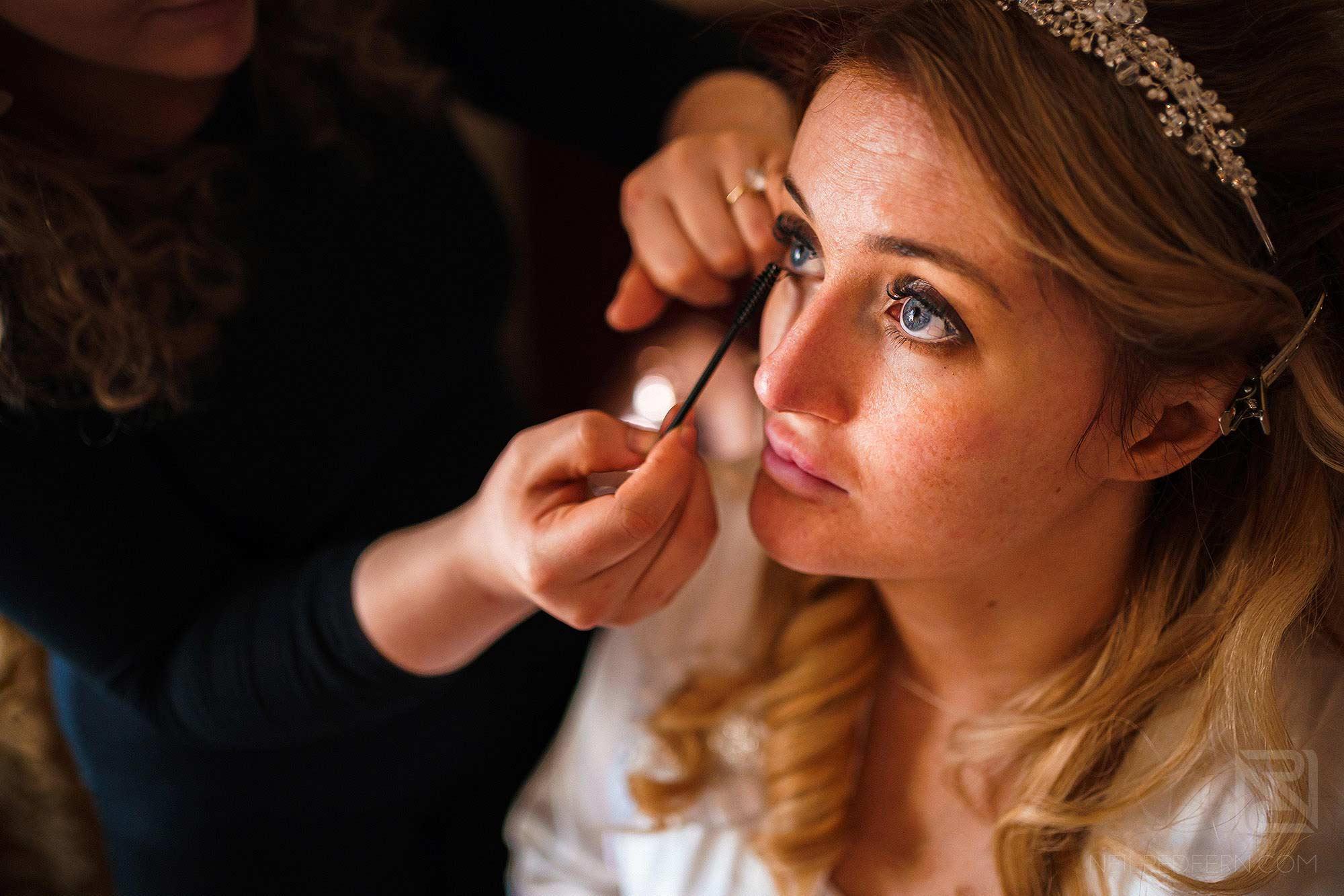 bride having make-up put on