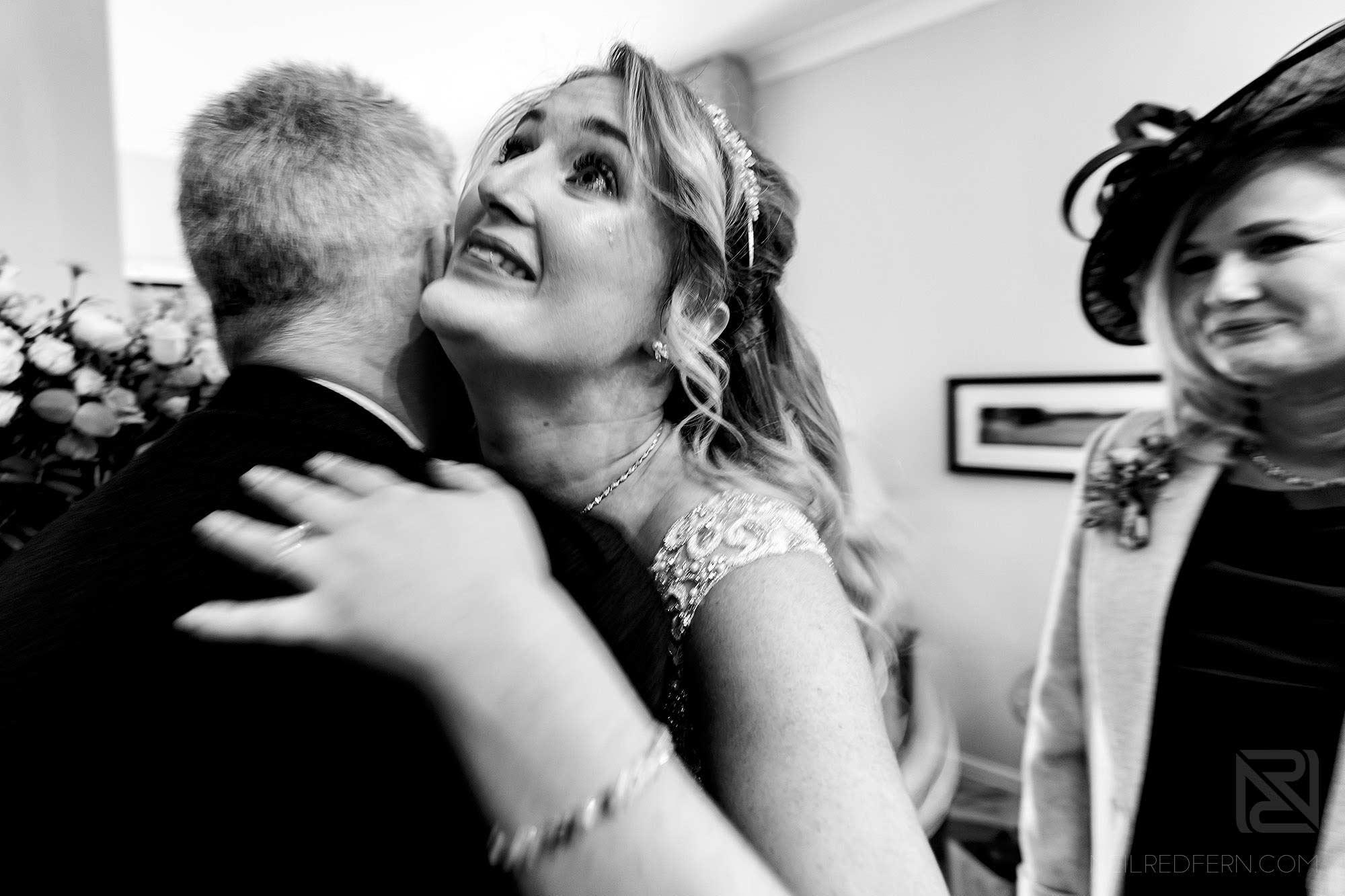 emotional bride hugging dad