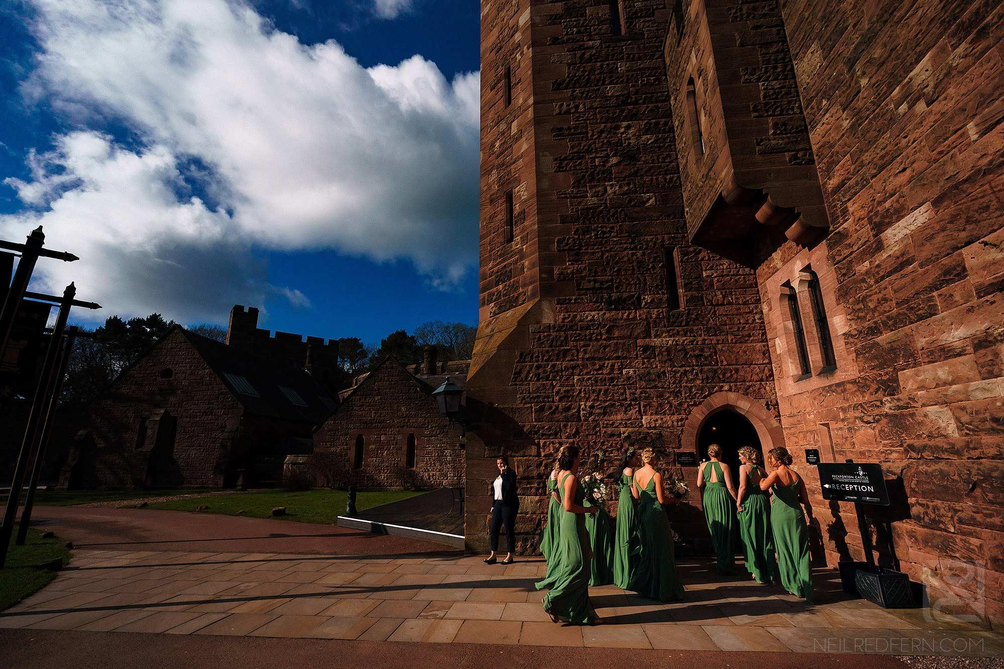 bridemaids walking in to Peckforton Castle