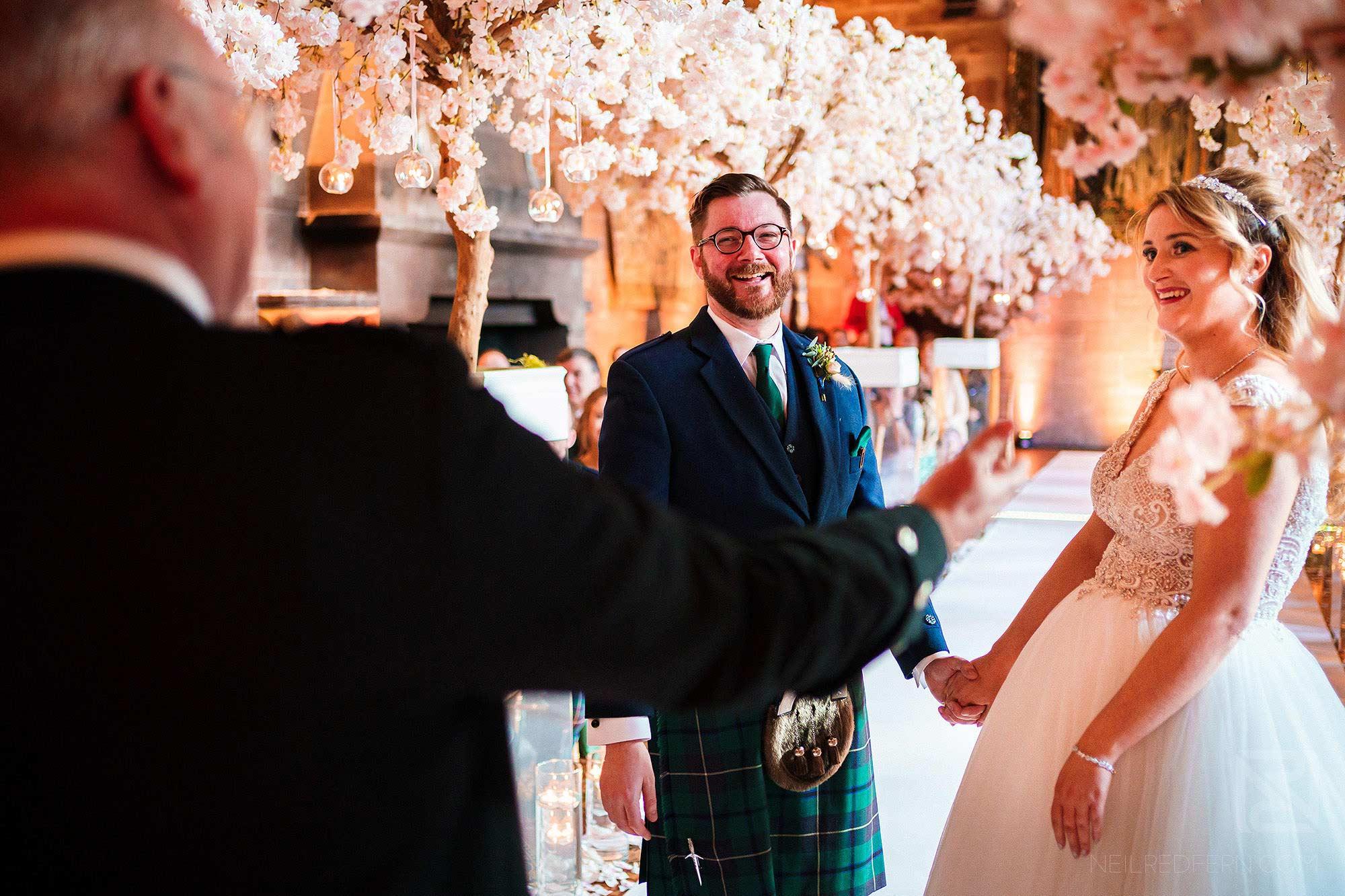 happy moment during Peckforton Castle wedding ceremony