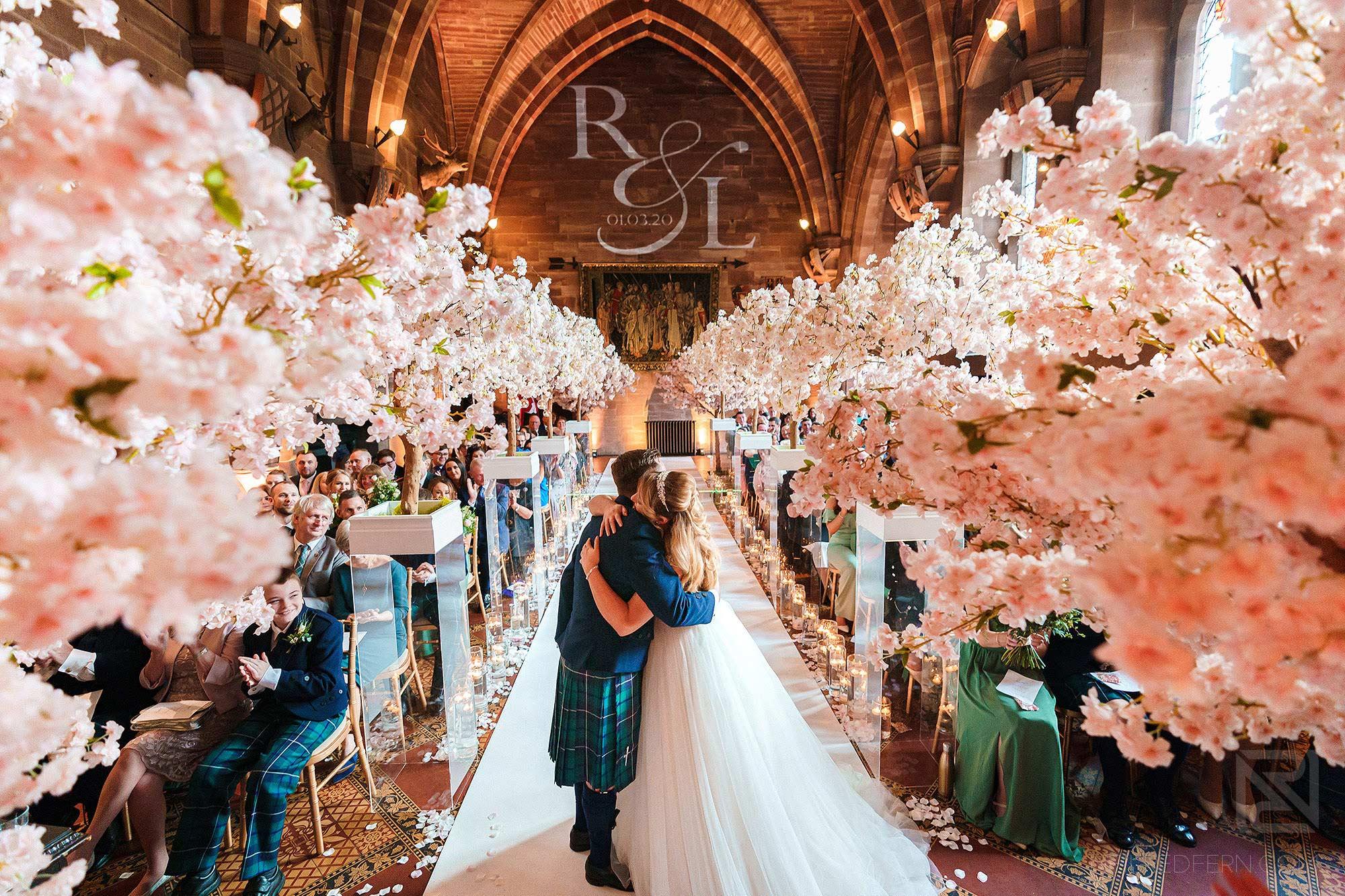 First kiss at Peckforton Castle wedding