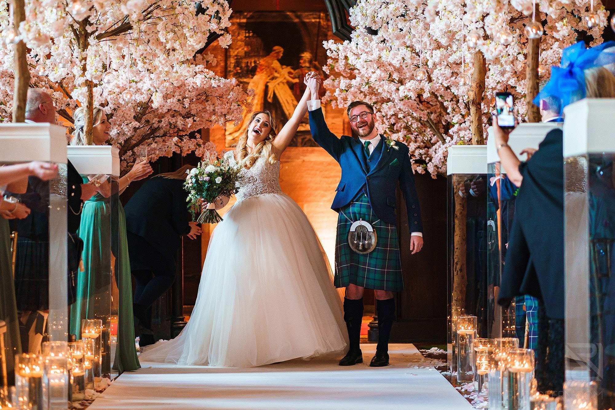 bride and groom celebrating during wedding ceremony