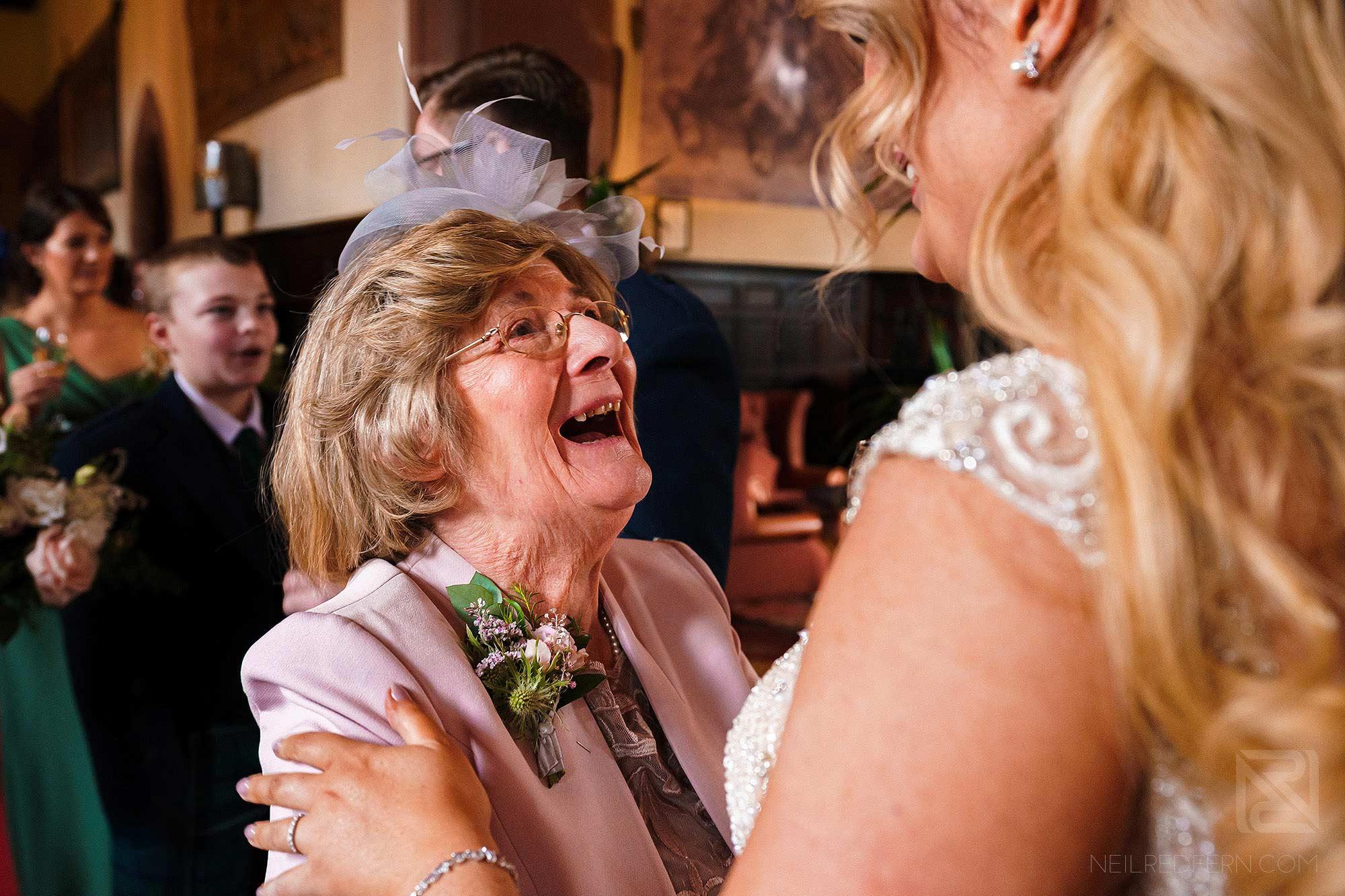 happy wedding guest at Peckforton Castle