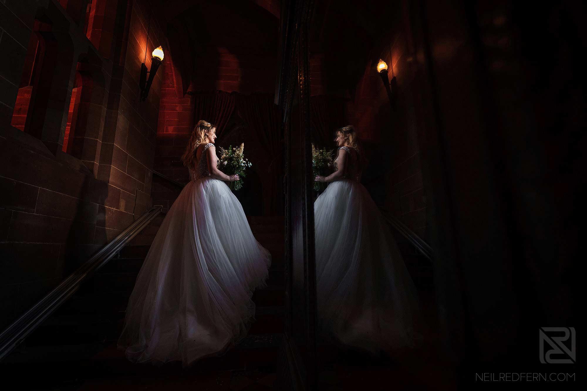 window light portrait of bride on stairs