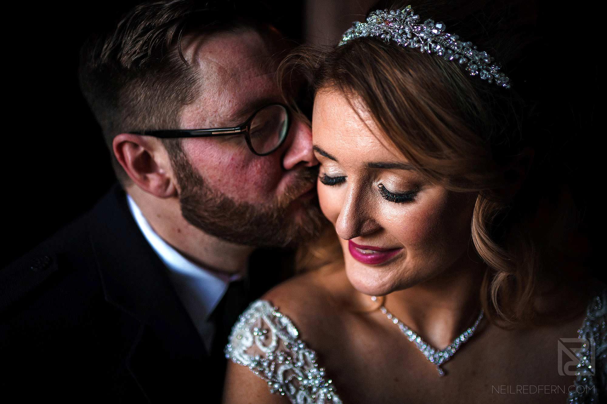 beautiful photograph of newlyweds at Peckforton Castle